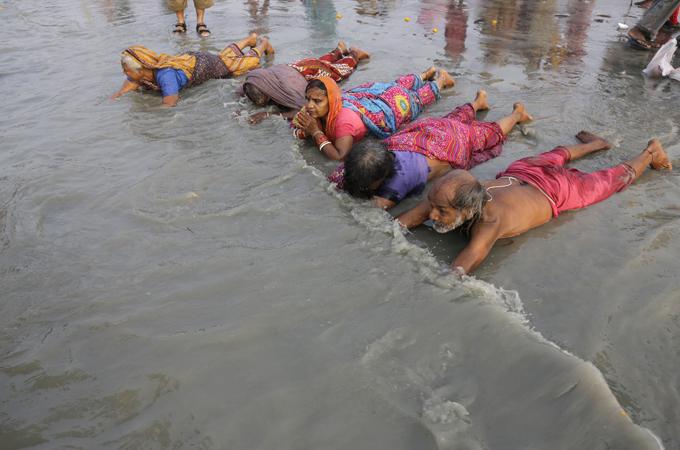 ganges mature women personals Millions of hindus plunge into ganges river in india to wash away their sins   men in underpants, women in saris and children – naked and.