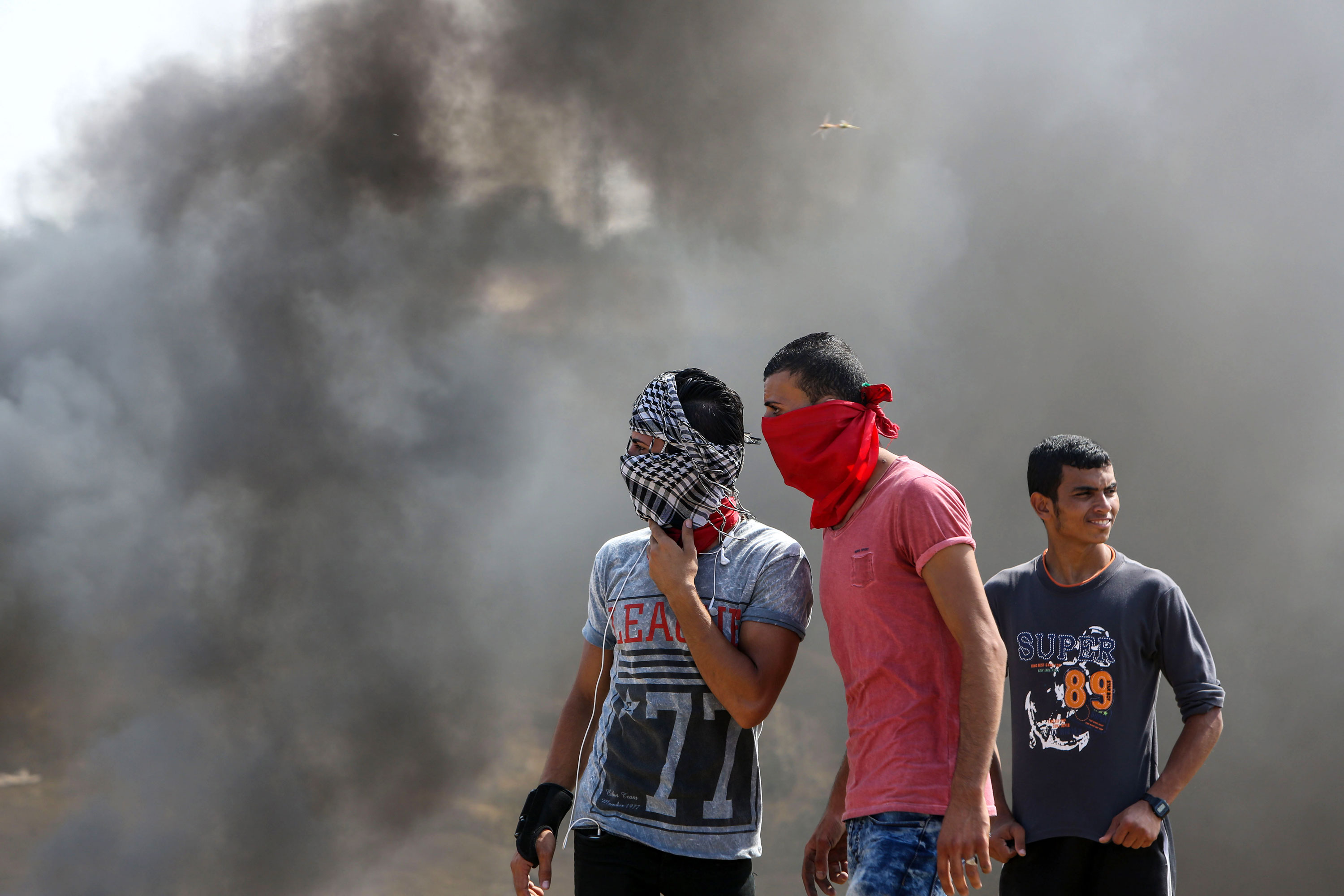 Israeli soldiers shot and killed two Palestinian teens in the Gaza Strip during confrontations. [Wisam Nasser/Al Jazeera]