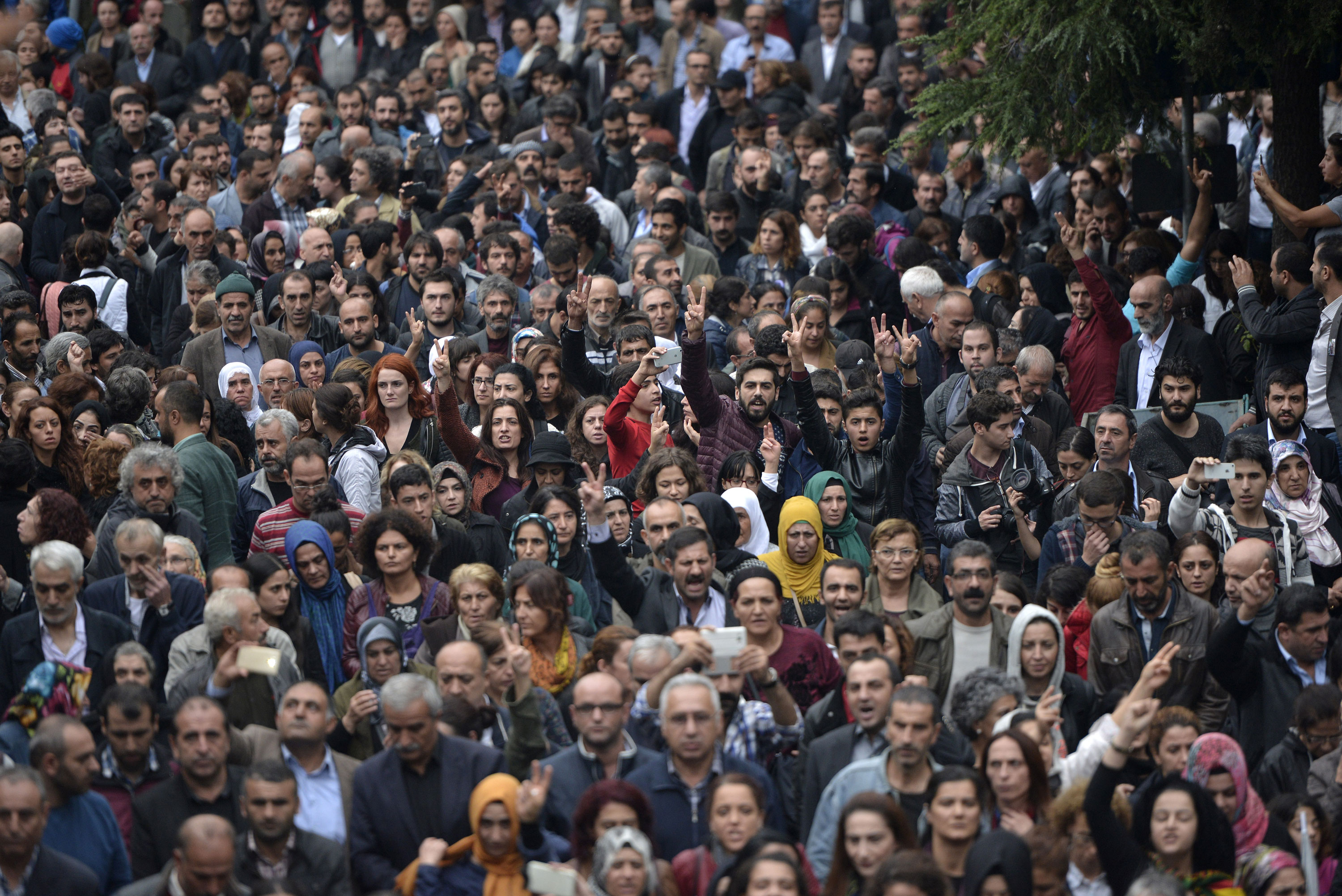 Hundreds of mourners gather to remember the 95 people killed in twin blasts at a peace rally on Saturday, the worst attack in Turkey's modern history. [Deniz/EPA]