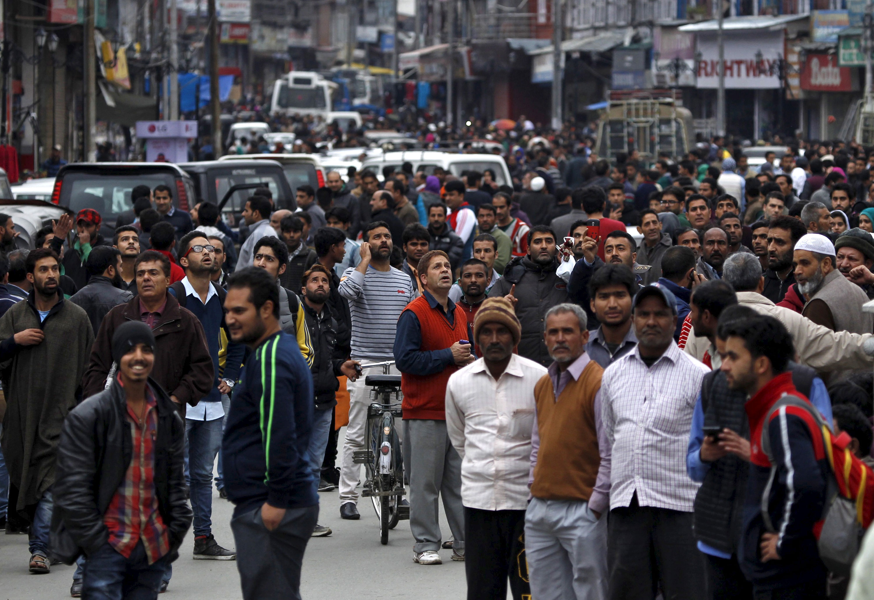 People stood in the streets after vacating homes and office buildings shortly after the earthquake struck in Srinagar in northern India. [Danish Ismail/Reuters]