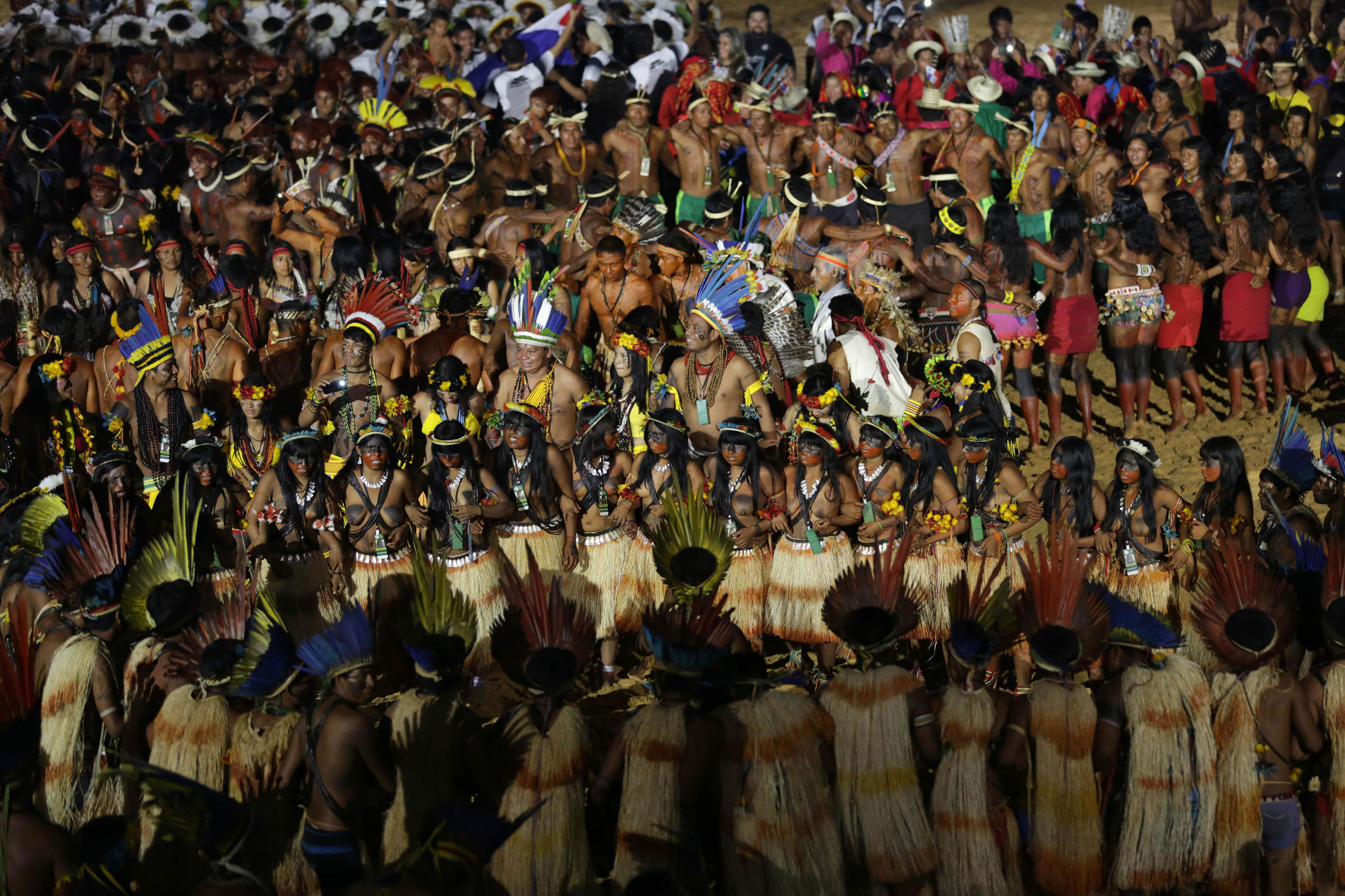 Indians from various ethnic groups and countries dance during the opening ceremony of the World Indigenous Games in Palmas, Brazil. [Eraldo Peres/AP]
