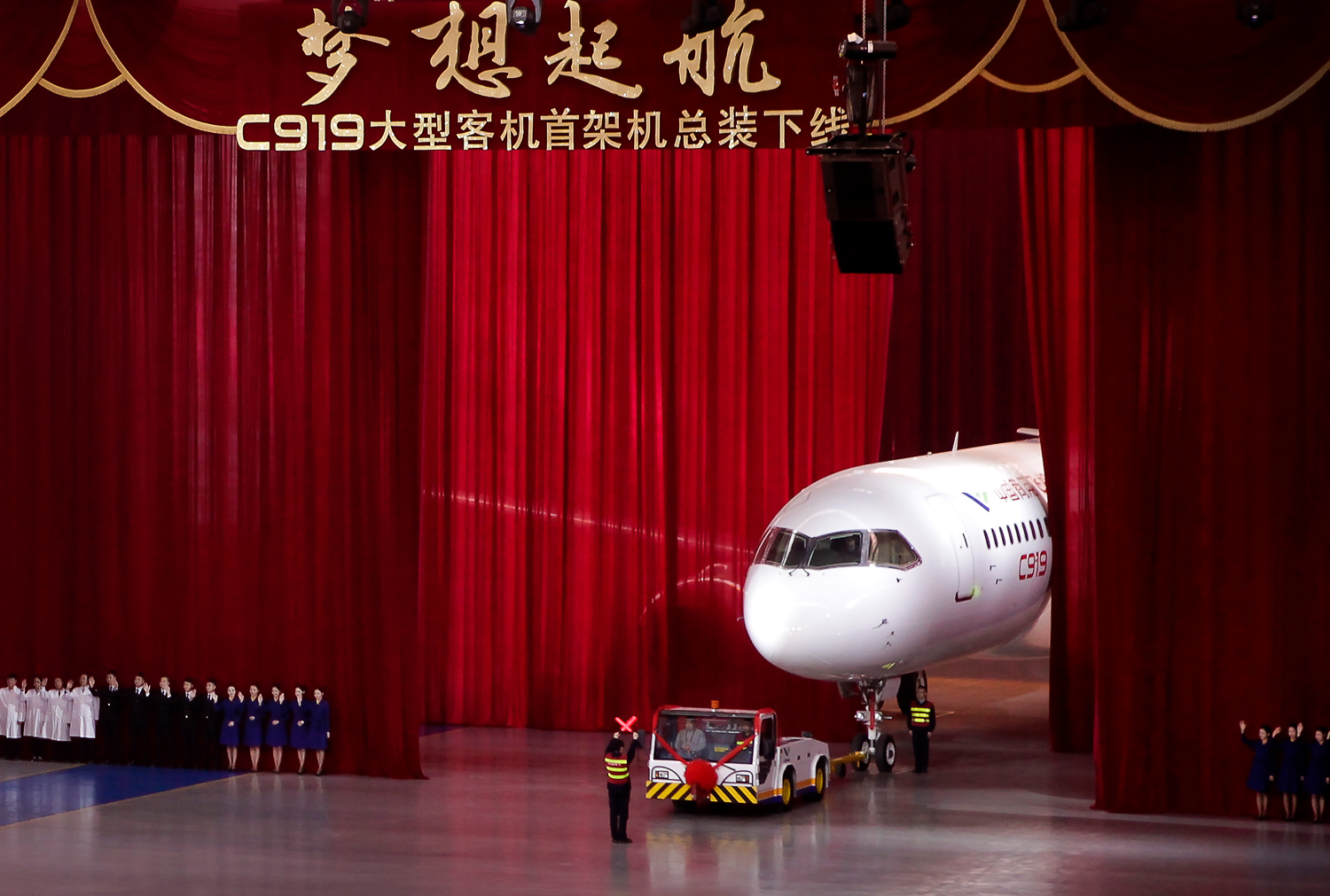 The first twin-engine 158-seater C919 passenger plane created by COMAC was presented during a ceremony at the company's hangar near the Pudong International Airport in Shanghai, China on Monday, Nov 2, 2015. [AP Photo]