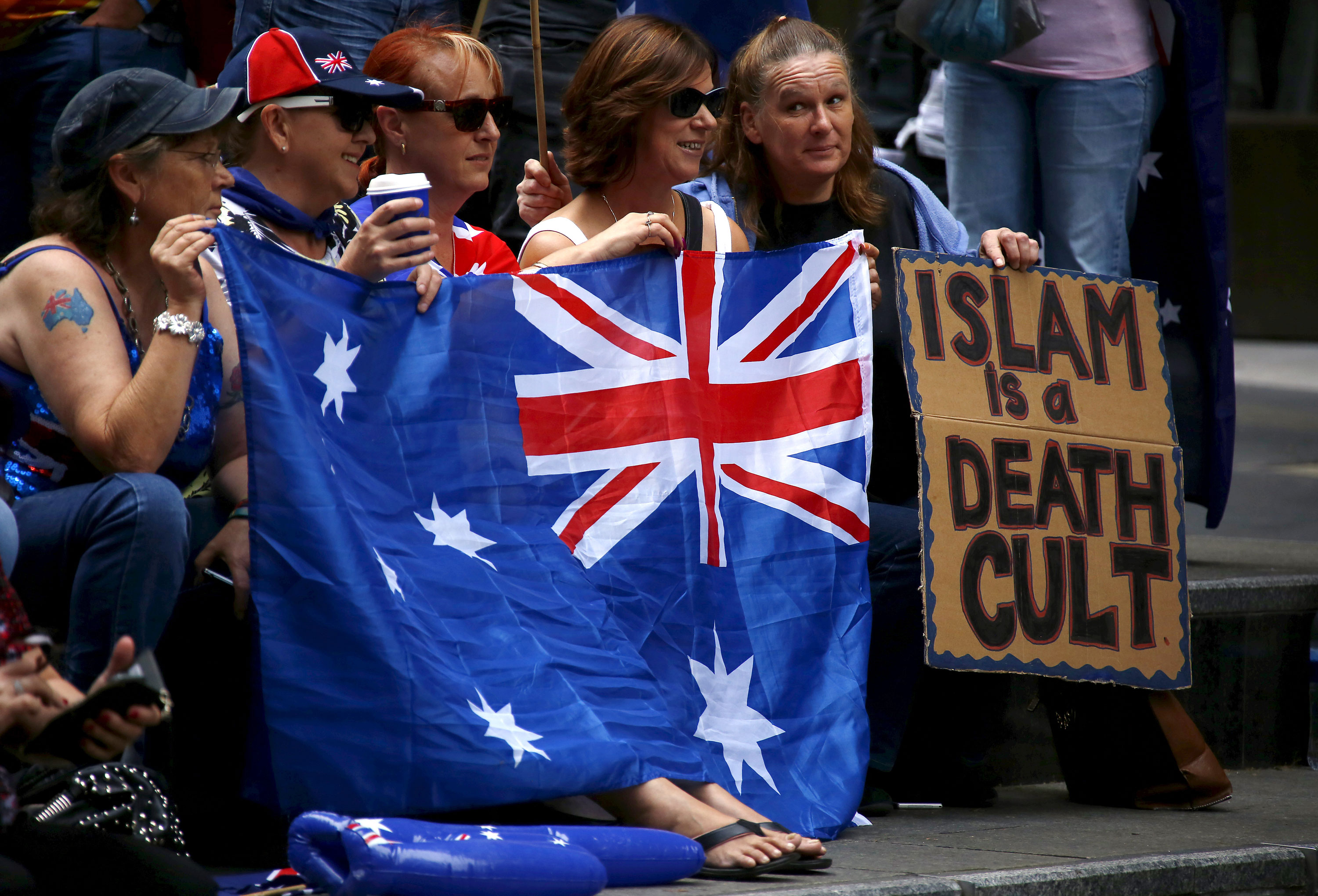 Anti-Islam demonstrators and a similar number of anti-racism activists held rallies in Sydney's Martin Place, as part of a national day of protest, with similar rallies in Melbourne and other cities. [David Gray/Reuters]