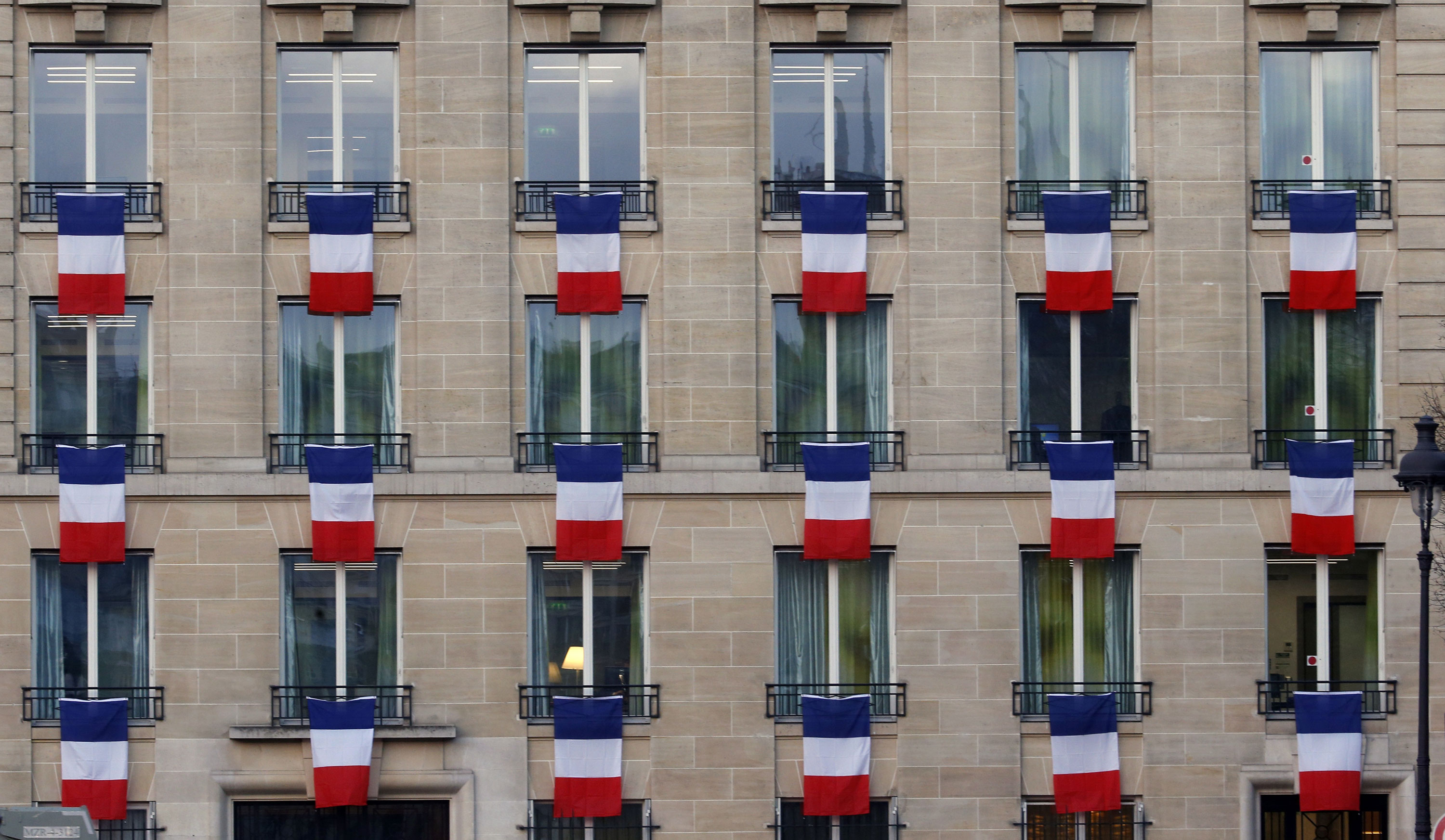 The French President Francois Hollande called on all French citizens to hang the tricolour national flag from their windows on Friday to pay tribute to the victims of the Paris attacks [Jacky Naegelen/Reuters]