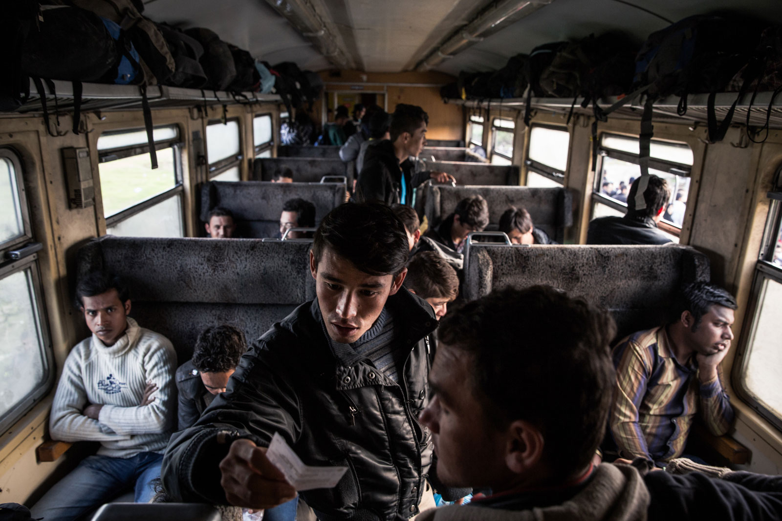 Refugees board trains from the transit camp in Gevgelija, Macedonia. Six or seven trains a day take refugees to the border with Serbia. [Ioana Moldovan/Al Jazeera]