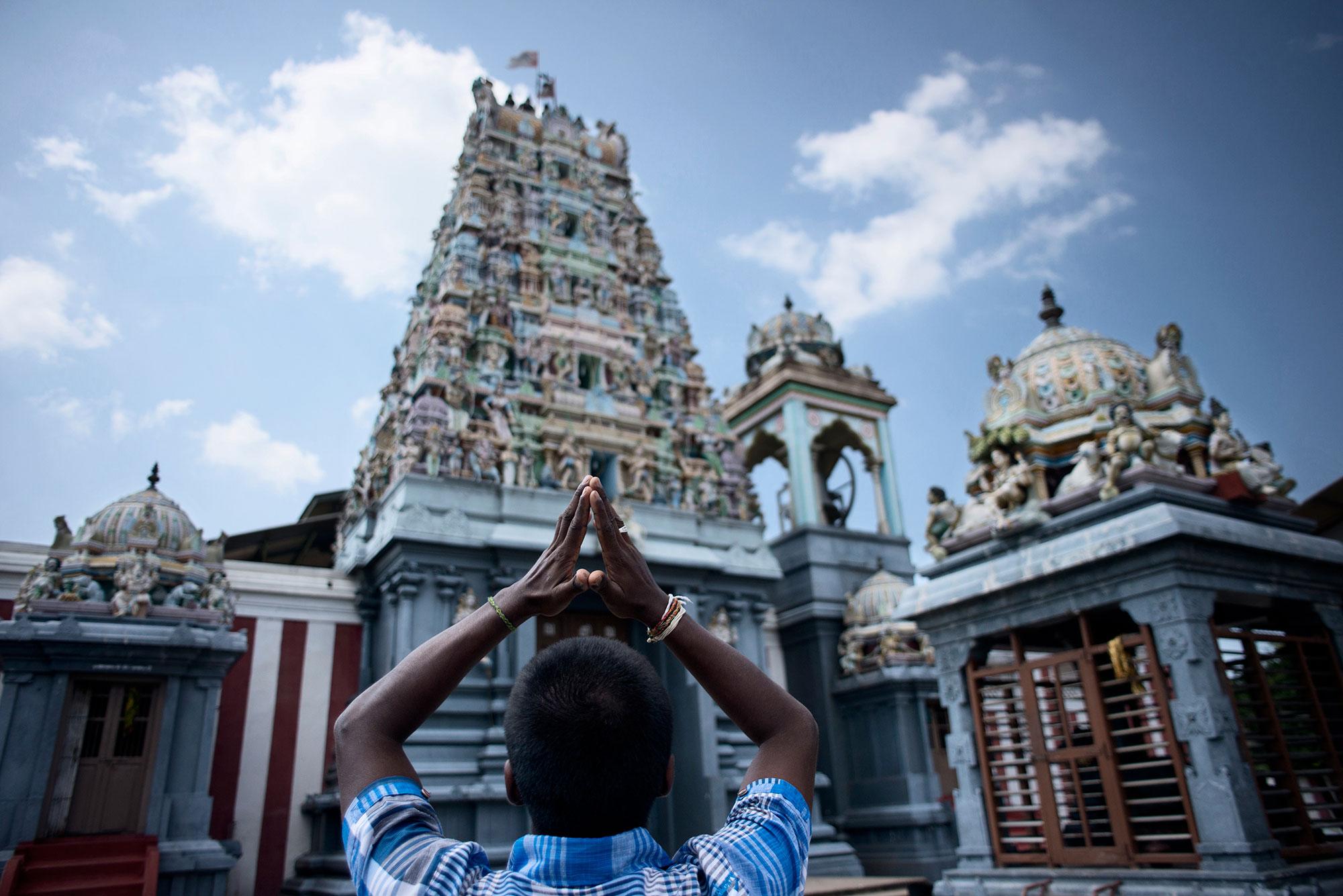 A Tamil devotee prays at a Hindu temple in Mannar district, in Sri Lanka's northwest. [Miguel Candela/Al Jazeera]