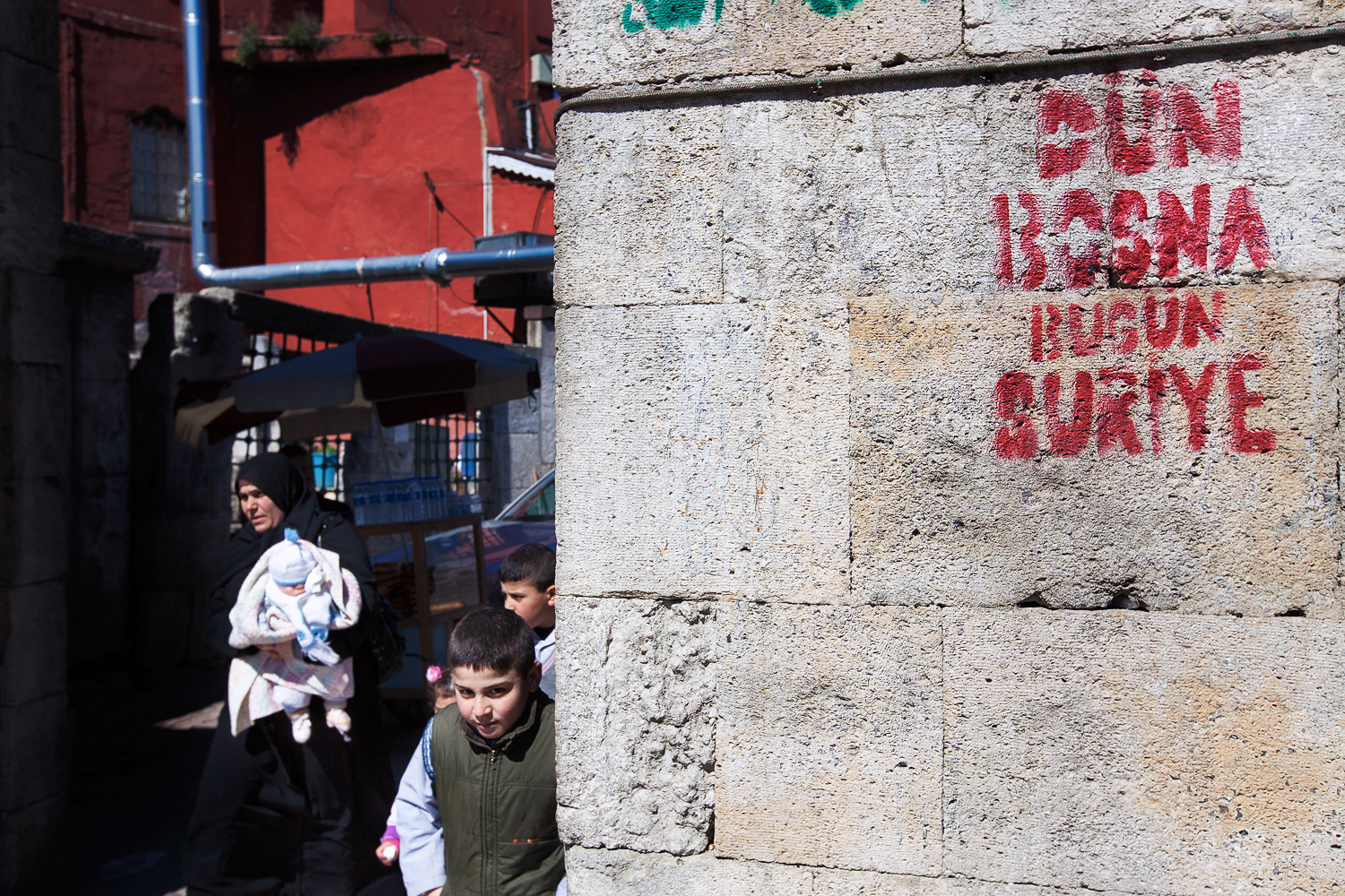 The wall near the Fatih mosque bears a slogan reading: 'Yesterday Bosnia, today Syria'. The Syrian community in Turkey is now estimated at 1.5 million people. [Mauro Prandelli/Transterra Media]