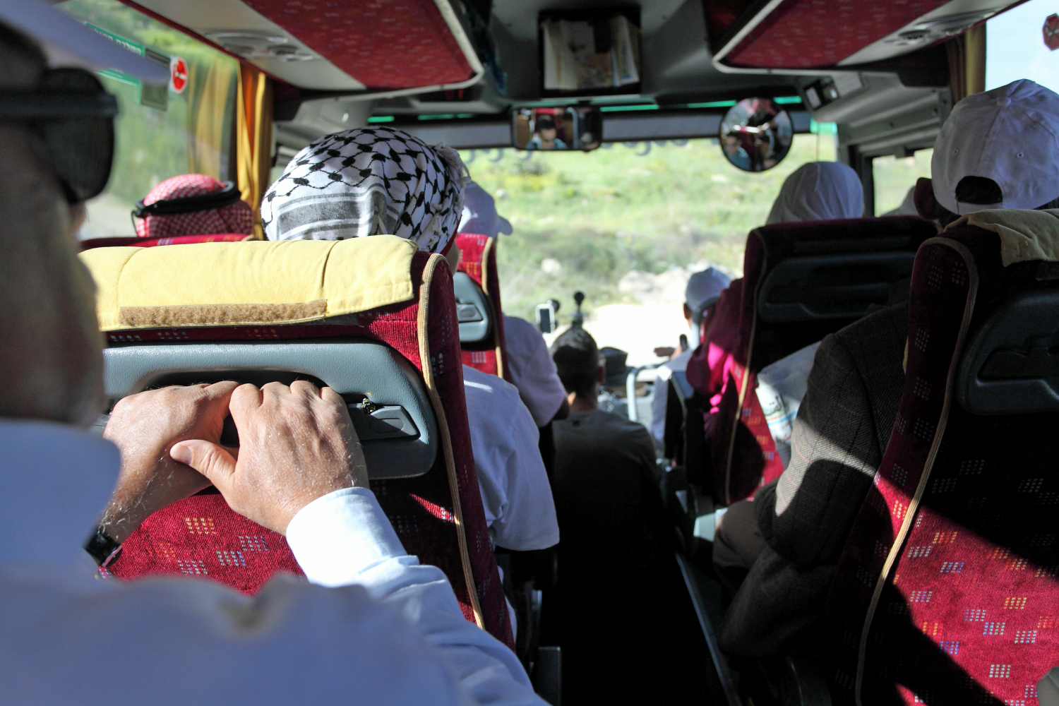Lifta's refugees piled into three buses, along with many cars and vans, to make the 10-minute journey from French Hill in East Jerusalem back to their village. [Rich Wiles/Al Jazeera]