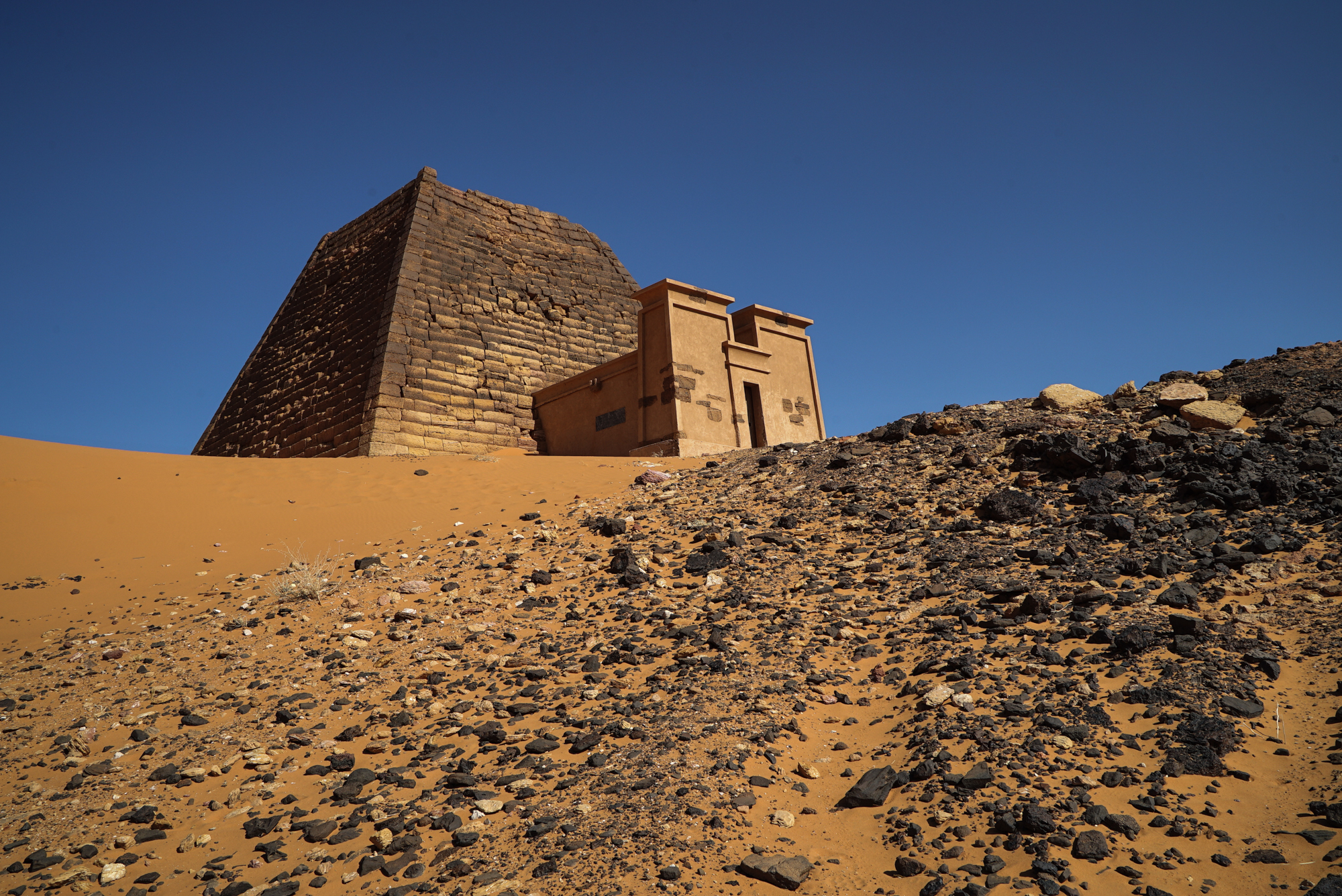 The Nubian Meroe pyramids are the best preserved of the more than 220 pyramids in Sudan. They are the burial sites for more than 40 Nubian kings and queens of the Kush kingdom. [Sorin Furcoi/Al Jazeera]