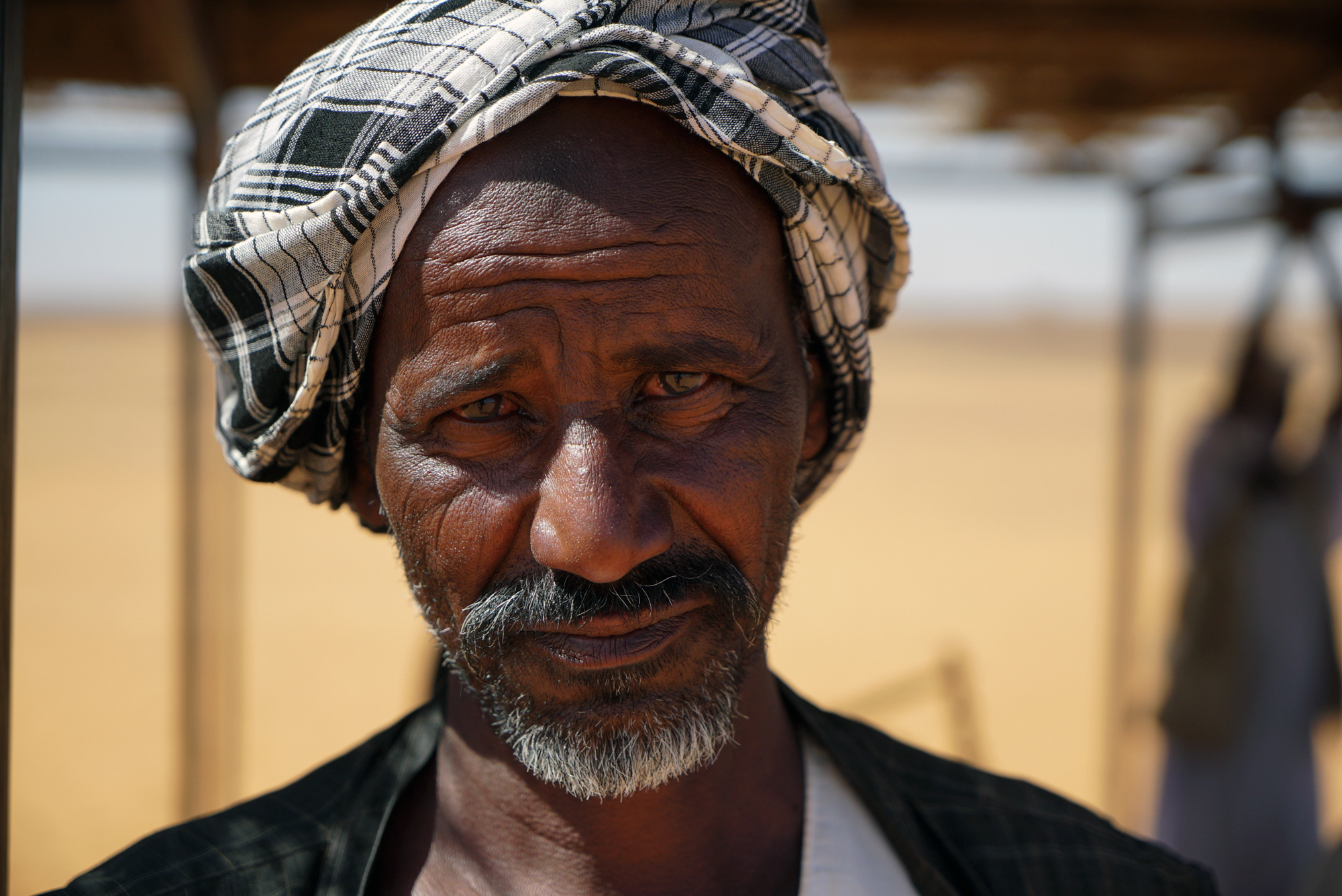 Abdullah is from Al Tarabil village, a few kilometres from the ancient burial site. 'This is our history. Here our ancestors are buried. We pay no tax for working here, but there aren't too many people coming to visit lately,' he said. In a good day he makes $10 to $16 offering tourists camel rides. [Sorin Furcoi/Al Jazeera]