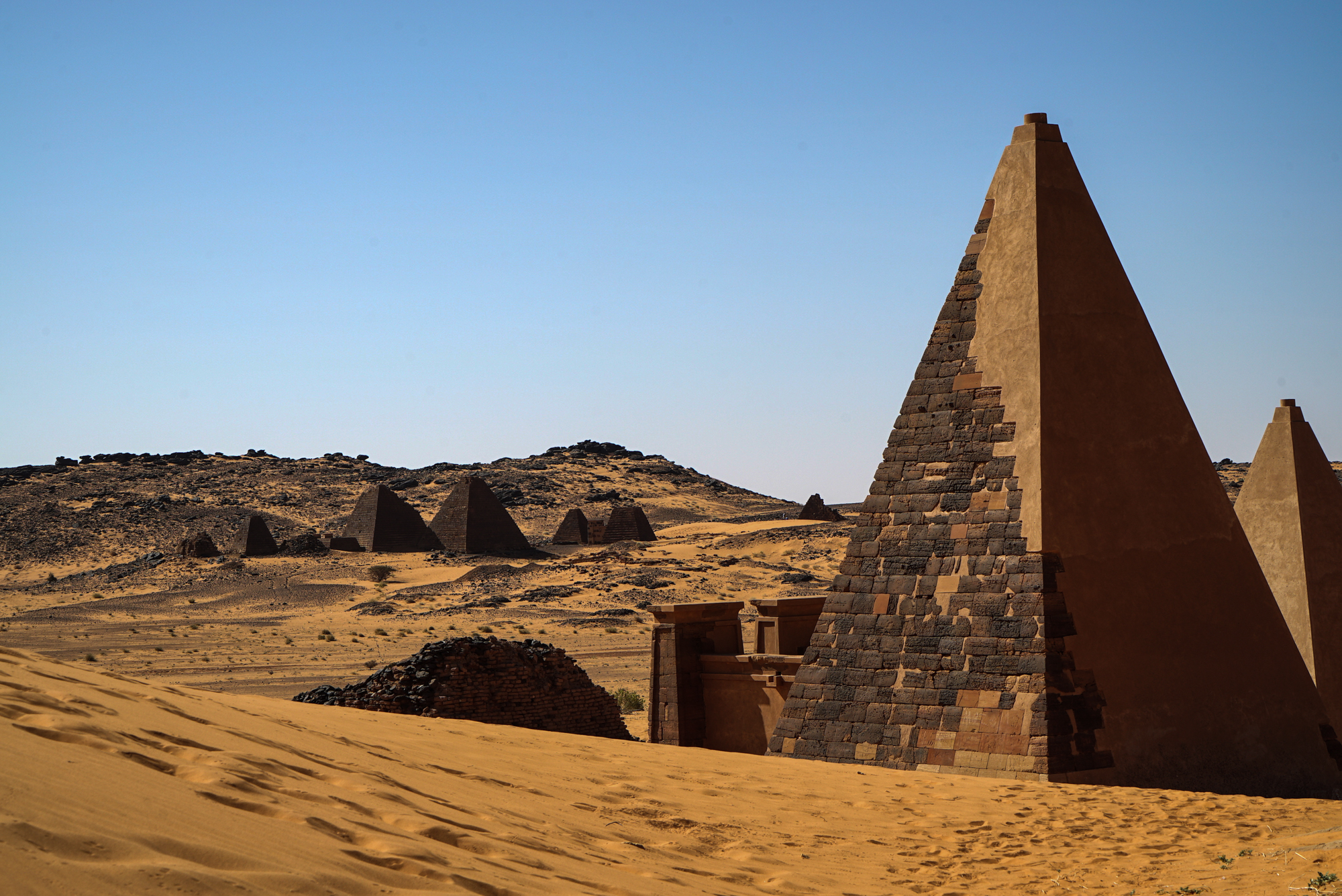 A few of the smaller pyramids have since been restored, looking new in comparison to their more battered neighbours. [Sorin Furcoi/Al Jazeera]