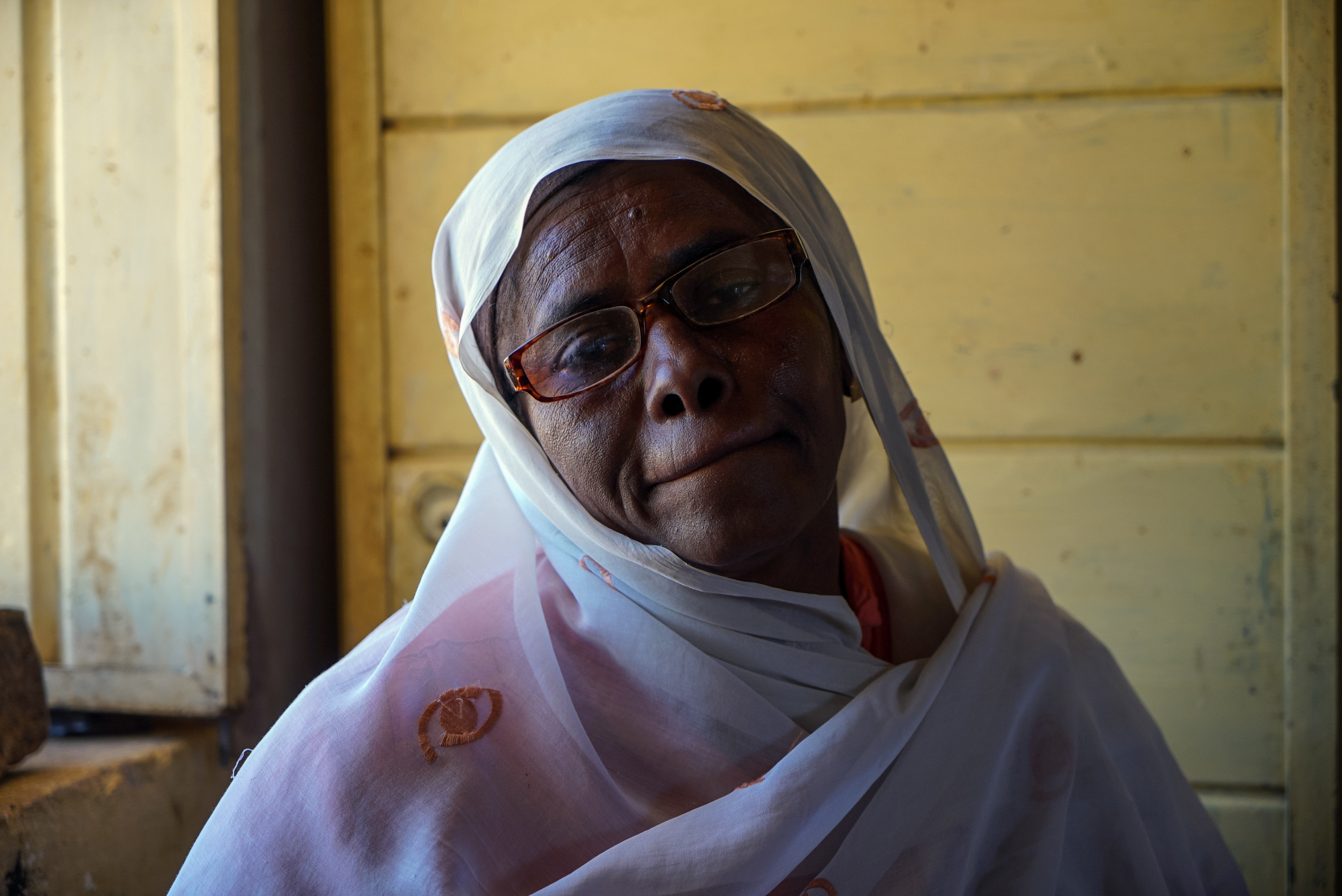 Fouzia works at the entrance of the site. 'Both Sudanese and foreigners visit the pyramids,' she said. 'But in the past, more people used to come. This year they weren't so many. Maybe all the news about Ebola and other wars in Africa scared the foreigners away.' [Sorin Furcoi/Al Jazeera]