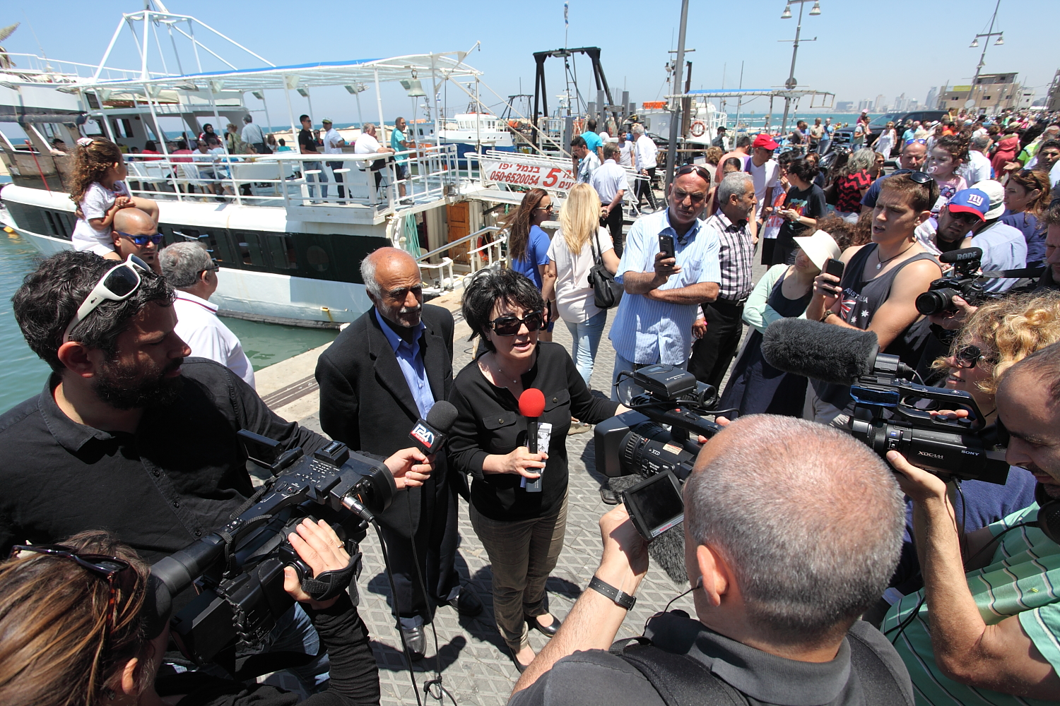 Haneen Zoabi, a Palestinian citizen of Israel and a representative of the Arab Joint List in the recent Israeli elections, joined activists in Jaffa. 'We cannot ignore the expelling of 85 percent of the Palestinian population [during the Nakba] and the establishment of a state that defines itself as a Jewish state,' she said. 'In my own homeland, I am considered a guest or an invader.' [Rich Wiles/Al Jazeera]