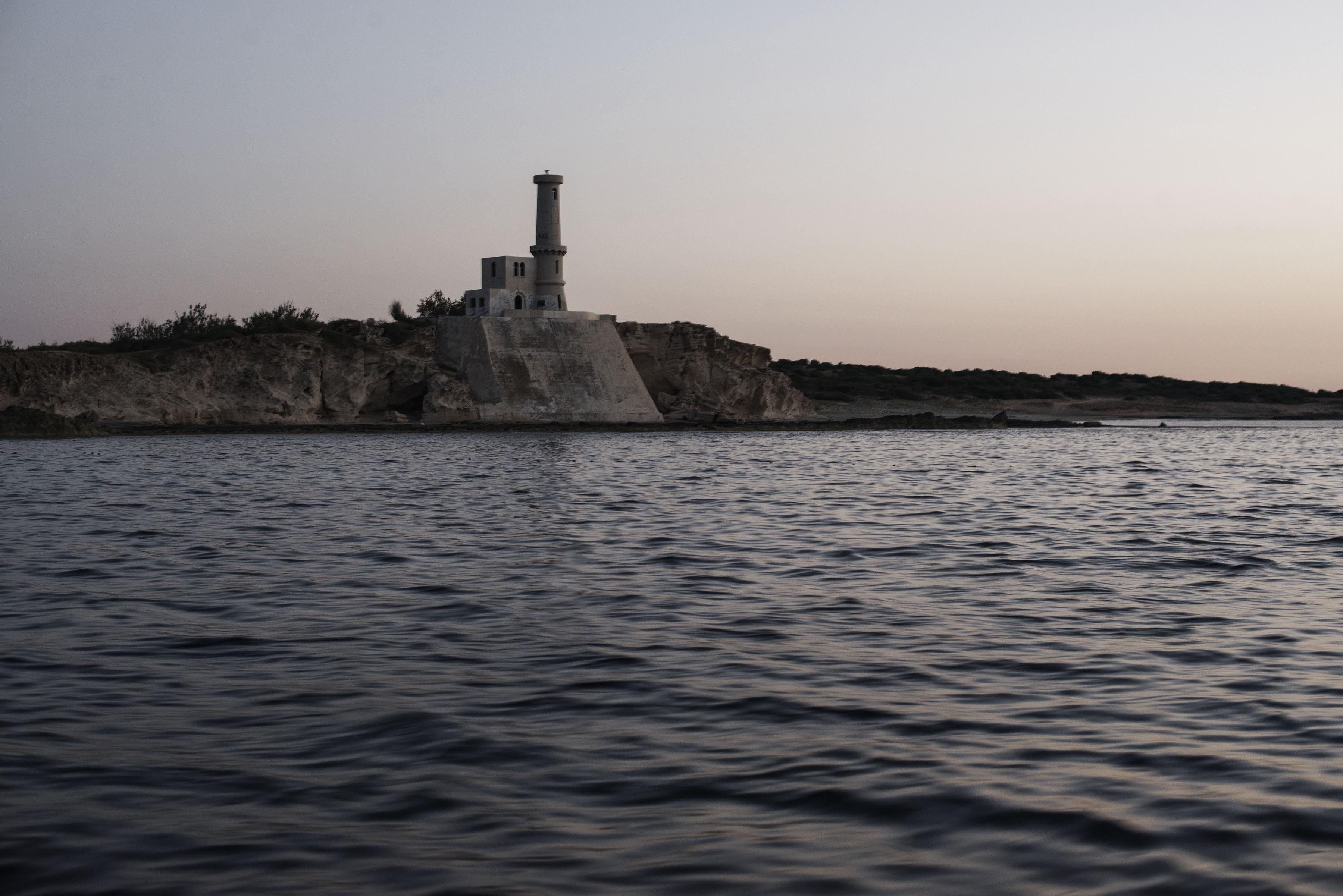 A non-functioning lighthouse on the beach of Garabulli. This part of the coast is often used by migrants to start their journey by sea in an effort to reach Italy. [Alessio Romenzi/CESURA/Al Jazeera]