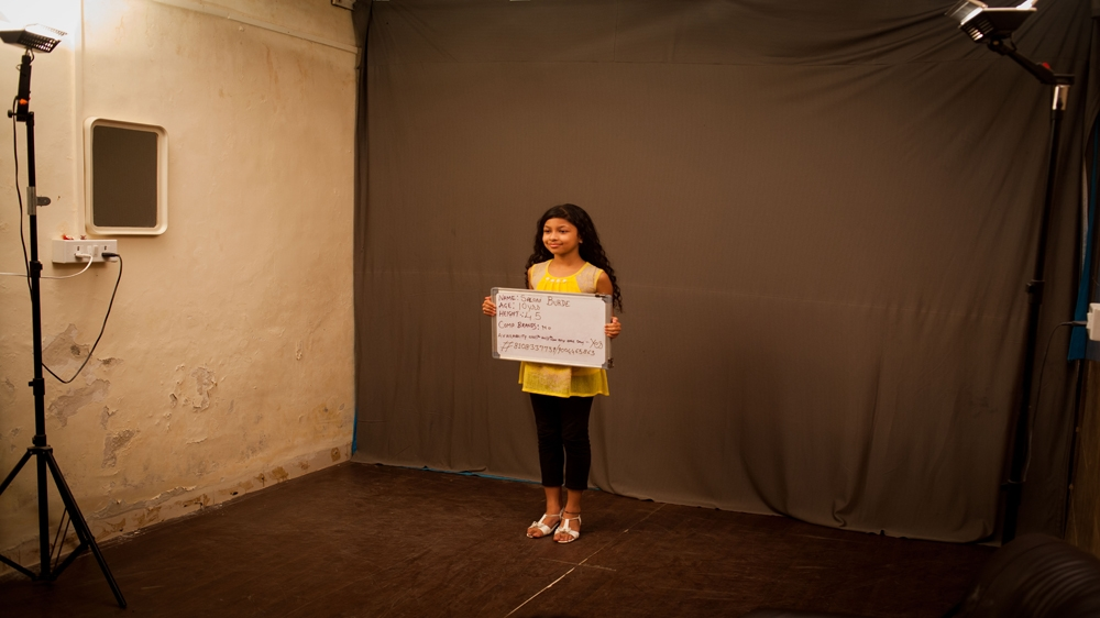 Ten Year Old Saloni Burde Holds A Board Stating Her Name Age And Height During An Audition For Chocolate Commercial In Studio Mumbai Karen Dias