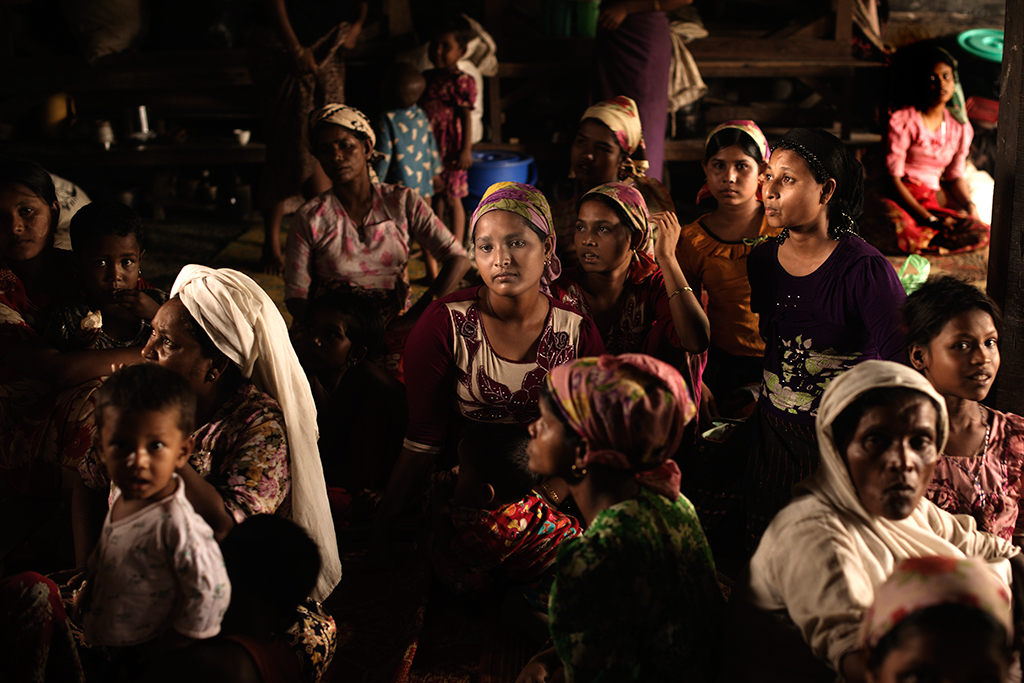 Mothers and children gather on the ground floor at the Thet Kay Pyin village Madrassa, Sittwe. Human Rights Watch accused the Myanmar government of involvement in a campaign of ethnic cleansing against the Rohingya. [Vincenzo Floramo/Al Jazeera]