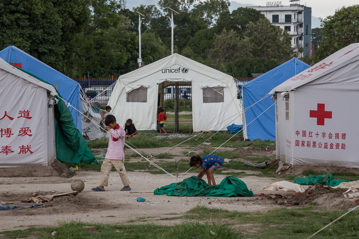 Children play in front of tents in a c& set up by international organisations in Ratna & Nepal two months after the deadly earthquake | | Al Jazeera