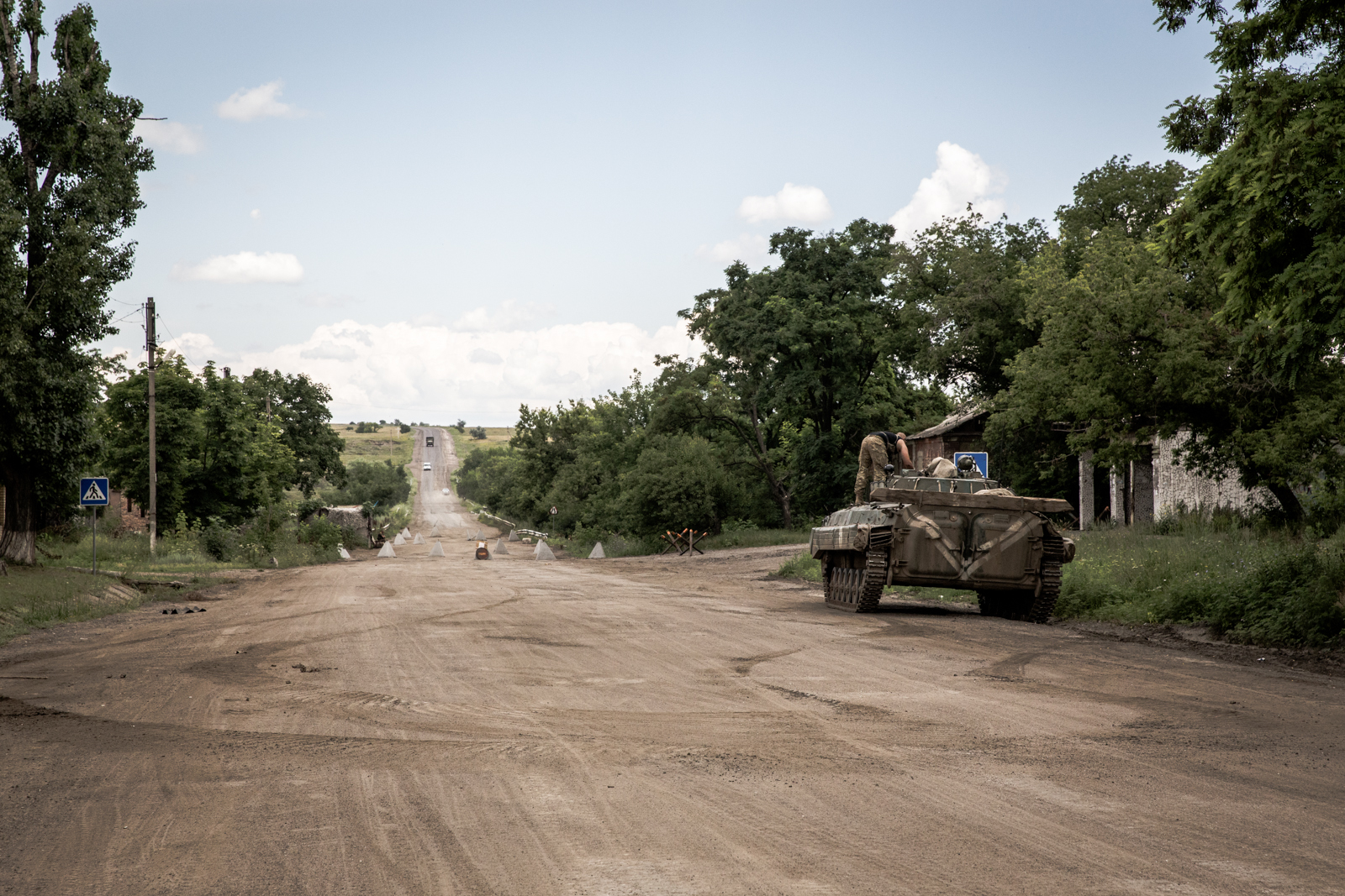 Luganskoje lies at the end of a 19km stretch of highway out of Debaltseve, the key eastern railway town now under rebel control that saw heavy fighting back in February 2015. [Ioana Moldovan/Al Jazeera]