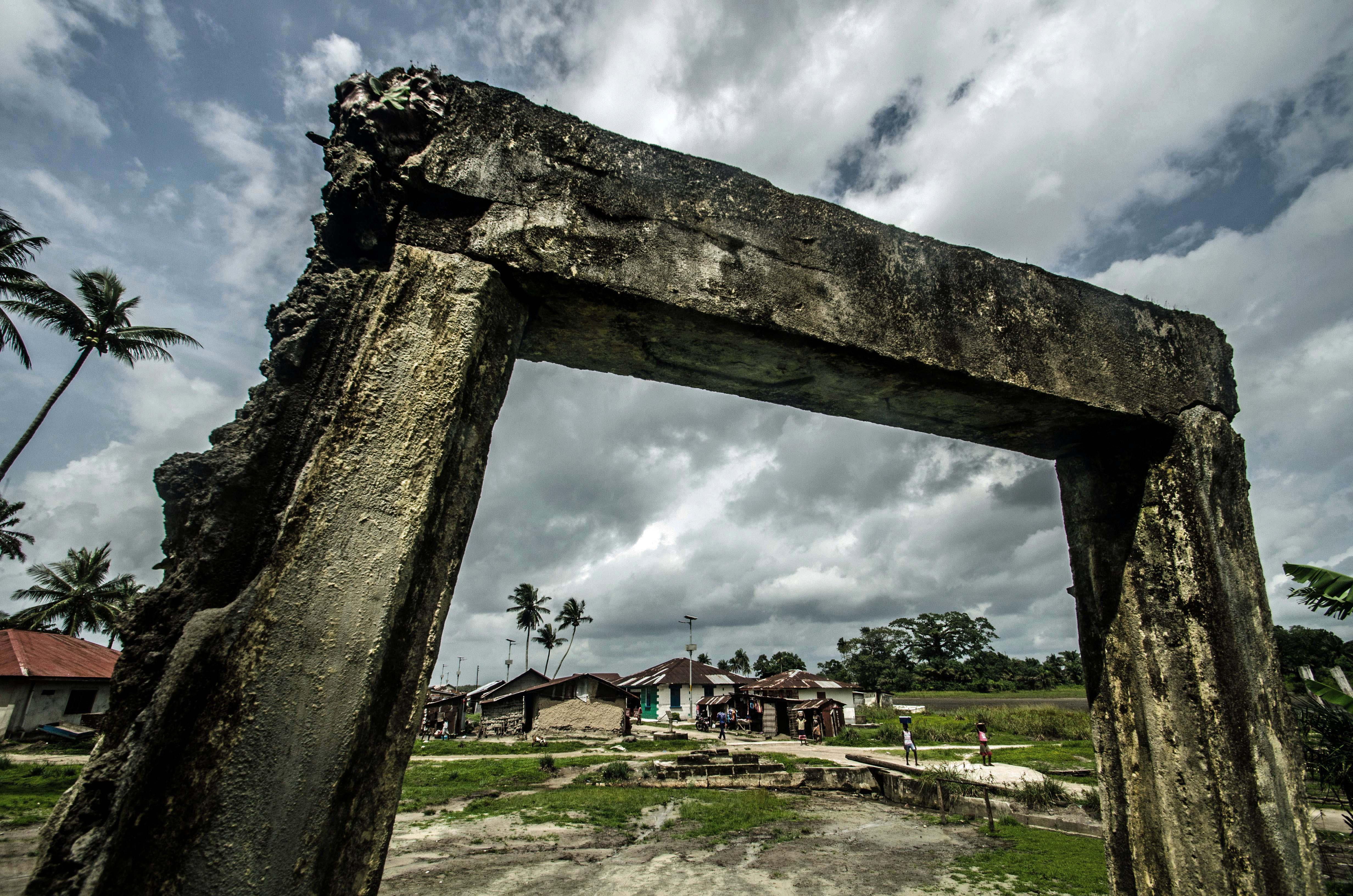 A solitary arch is all that remains of a building on the edge of Bonthe Town. [Tommy Trenchard/Al Jazeera]