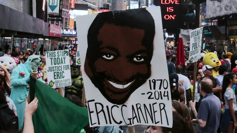 Protesters march through Times Square for Eric Garner's anniversary