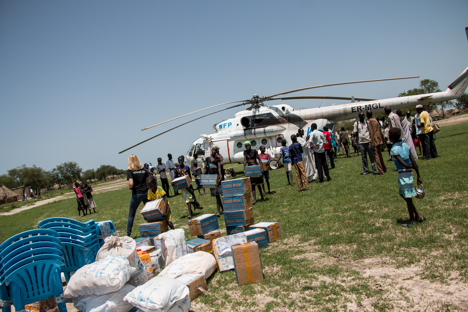 A crisis response team landed in the swamplands of Jonglei state by helicopter in order to provide up to 54,000 people with emergency aid [Ashley Hamer/Al Jazeera]