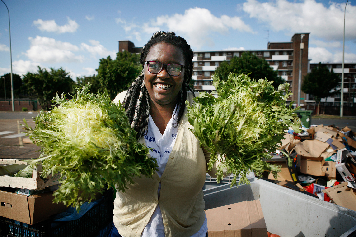 Kemi Akinola runs the Brixton People's Kitchen, and finds discarded ingredients at a fruit and vegetable market [Silvia Boarini/Al Jazeera]