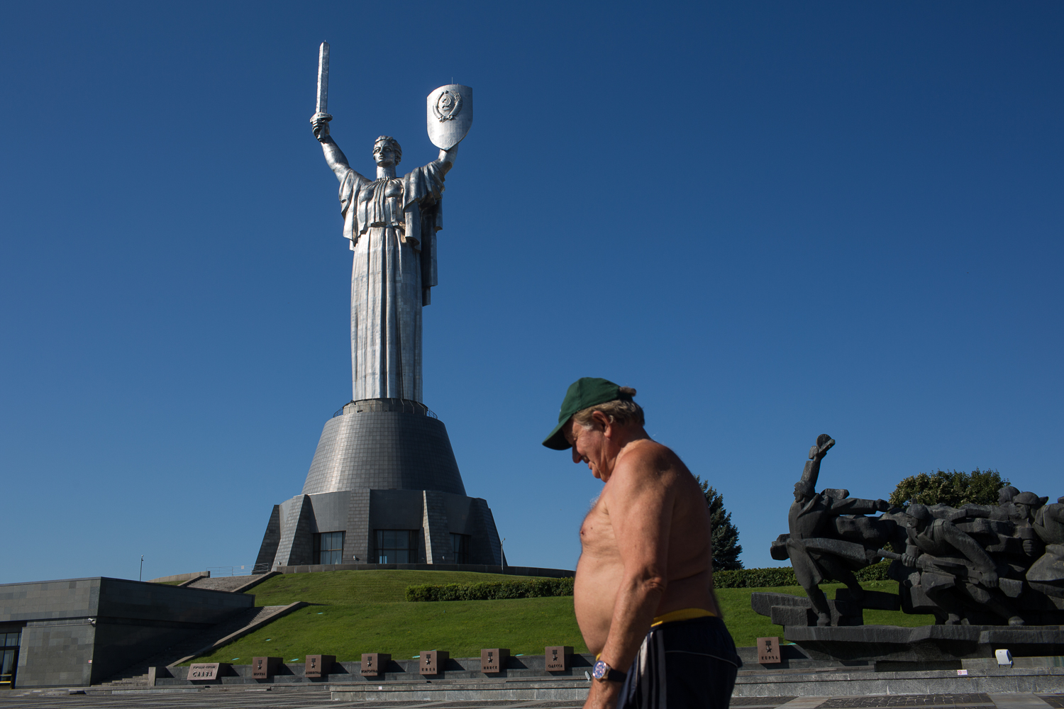 The 102-metre tall Rodina Mat monument in Kiev, complete with Soviet hammer and sickle on her shield, celebrates the WWII victory. Ukraine's history is closely intertwined with that of the Soviet Union. Many people are proud of the part their grandmothers and grandfathers played in winning WWII [John Wendle/Al Jazeera]