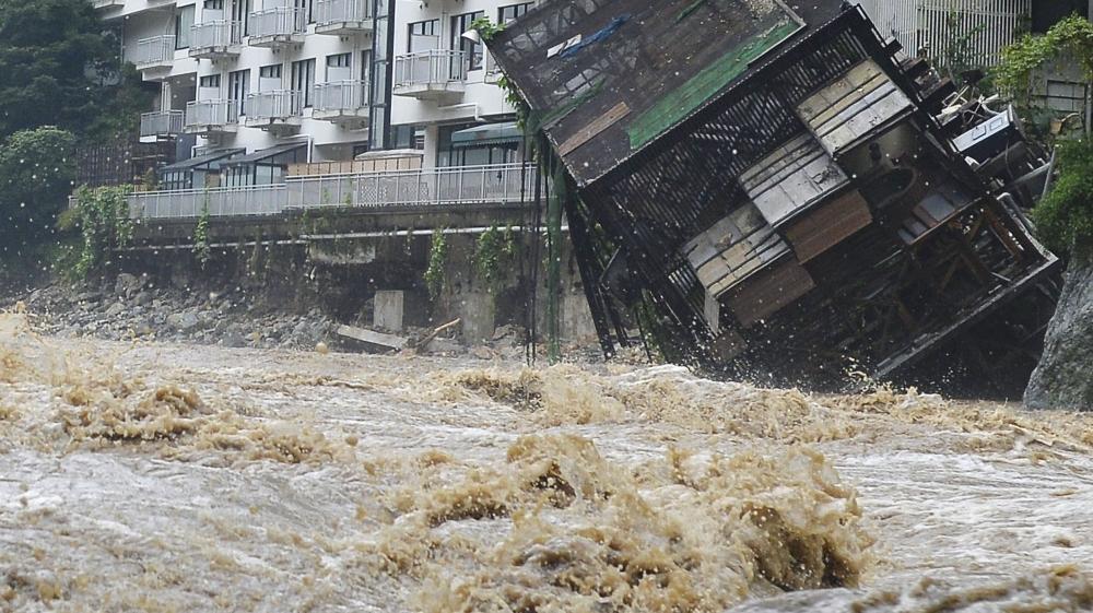Dramatic rescues as tsunami-like flood hits Japan city ...