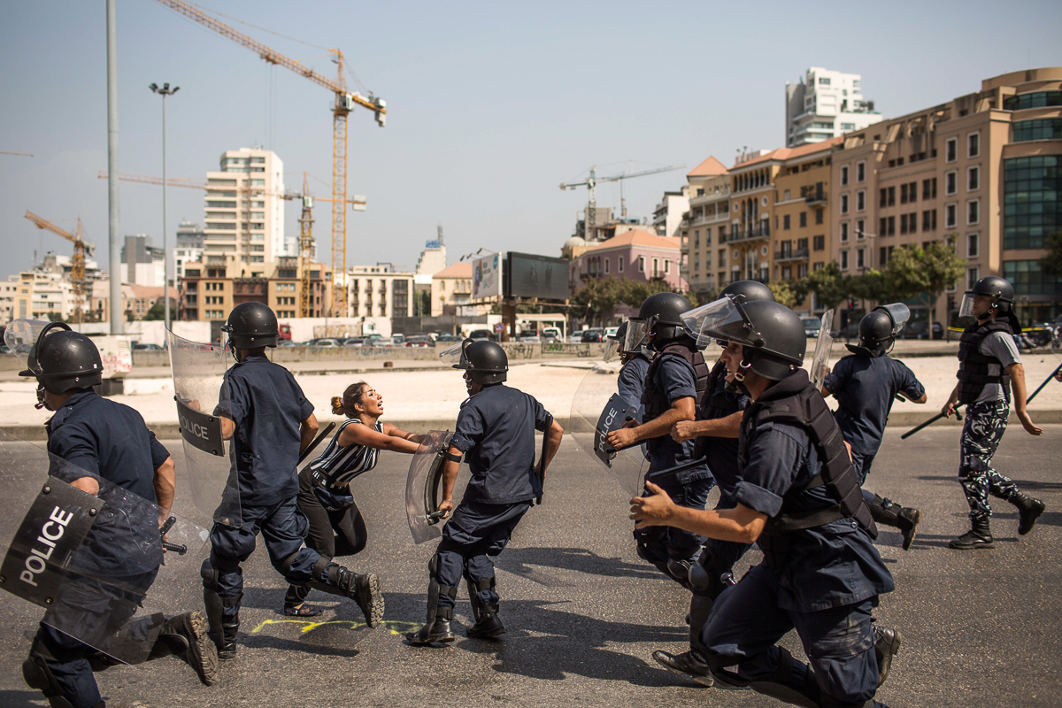 A Lebanese demonstrator tries to stop the police in Beirut. Lebanese people are still gathering to protest against the garbage crisis in Beirut, calling for the resignation of the government. [Diego Ibarra Sanchez/MeMo]