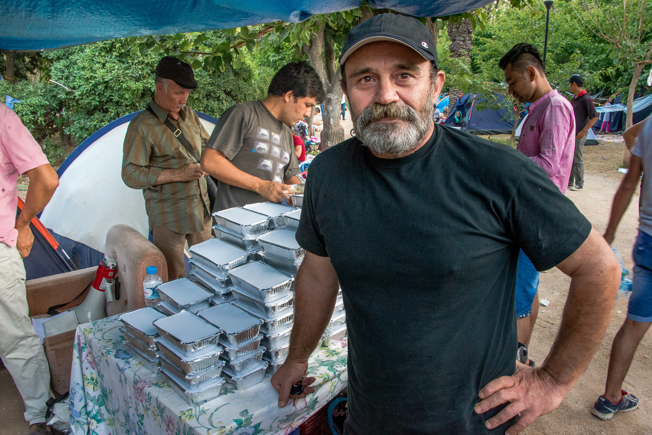 Konstantinos Polychronopoulos - founder of Social Kitchen - The Other Person - delivered 500 food rations at the temporary refugee camp in the Pedion tou Areos. [Dimitris Sideridis/Al Jazeera]