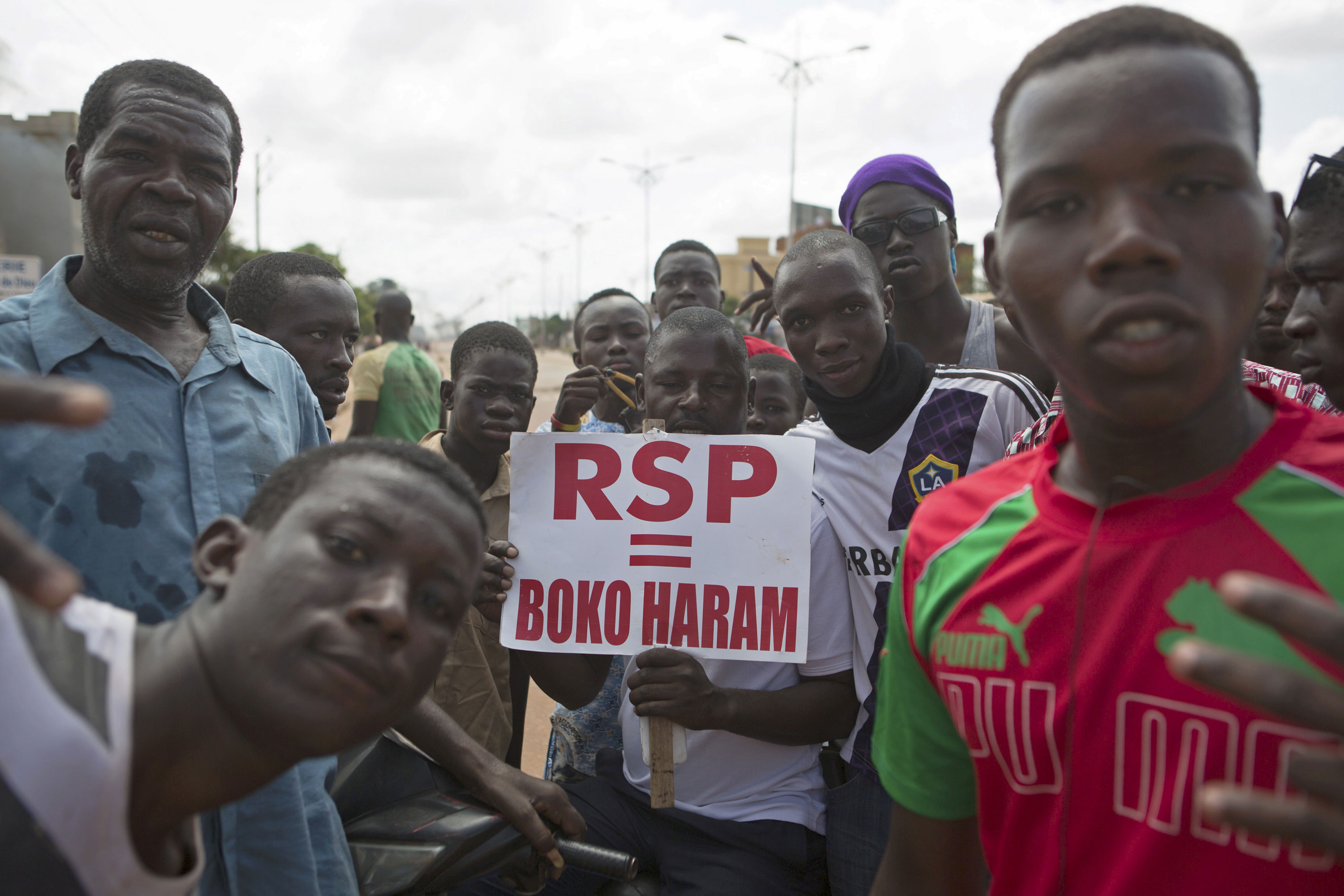 Burkina Faso coup leaders have freed interim President Michel Kafando and two of his ministers from detention hours after army soldiers entered the capital Ouagadougou without resistance. [Joe Penney/Reuters]
