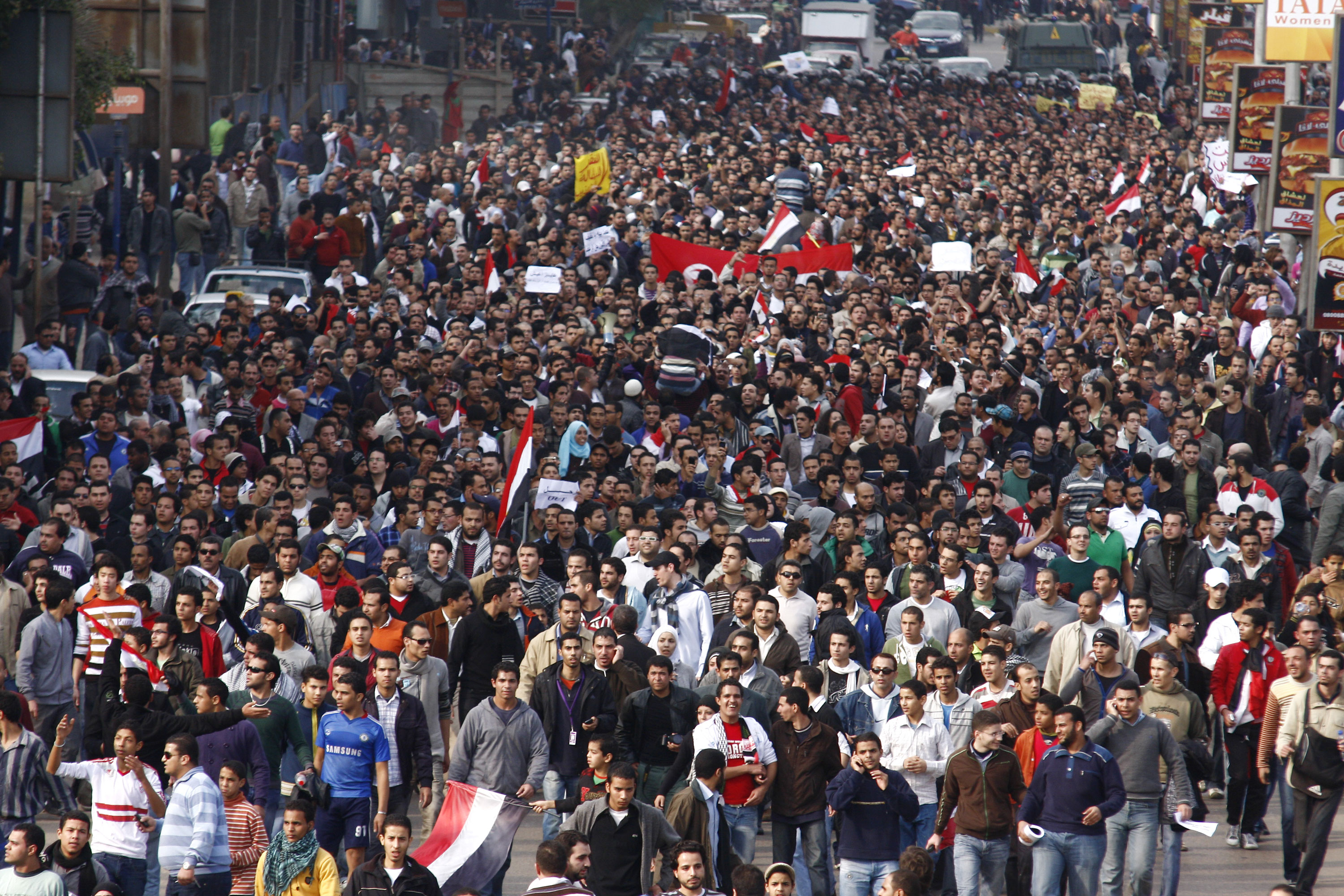 A crowd of demonstrators walks through Cairo on January 25, 2011, to demand the end of President Hosni Mubarak's nearly 30 years in power. [AP]