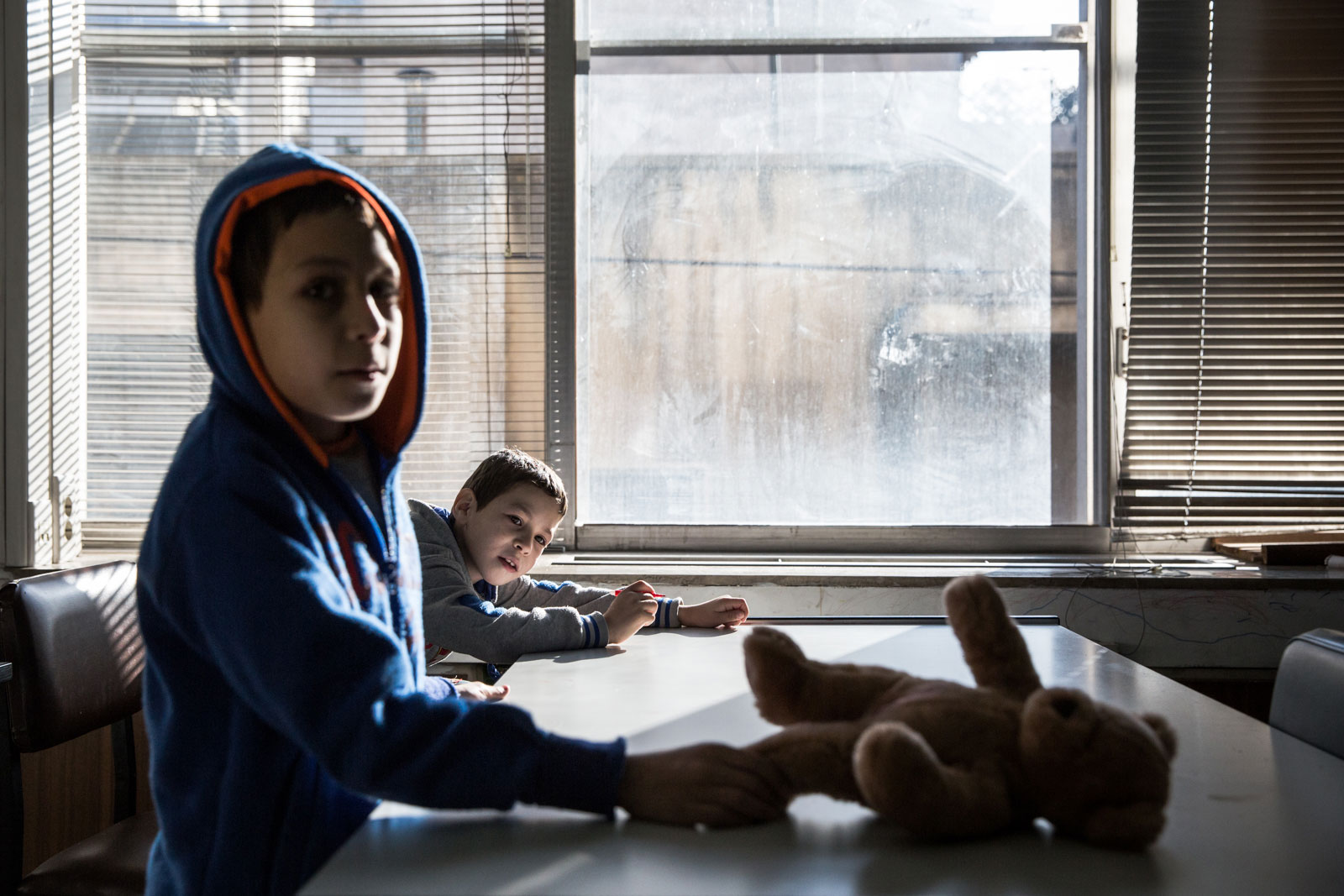 Children play in one of the rooms at 26 Notara Street, Athens, the former tax office that now houses refugees now trapped in Greece. [Ioana Moldovan/Al Jazeera]