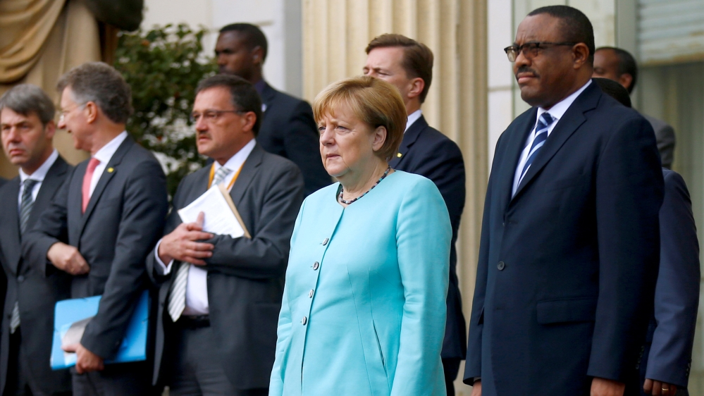 PM Hailemariam's comments come as Germany's Merkel visits troubled country and urges an opening of political space.
