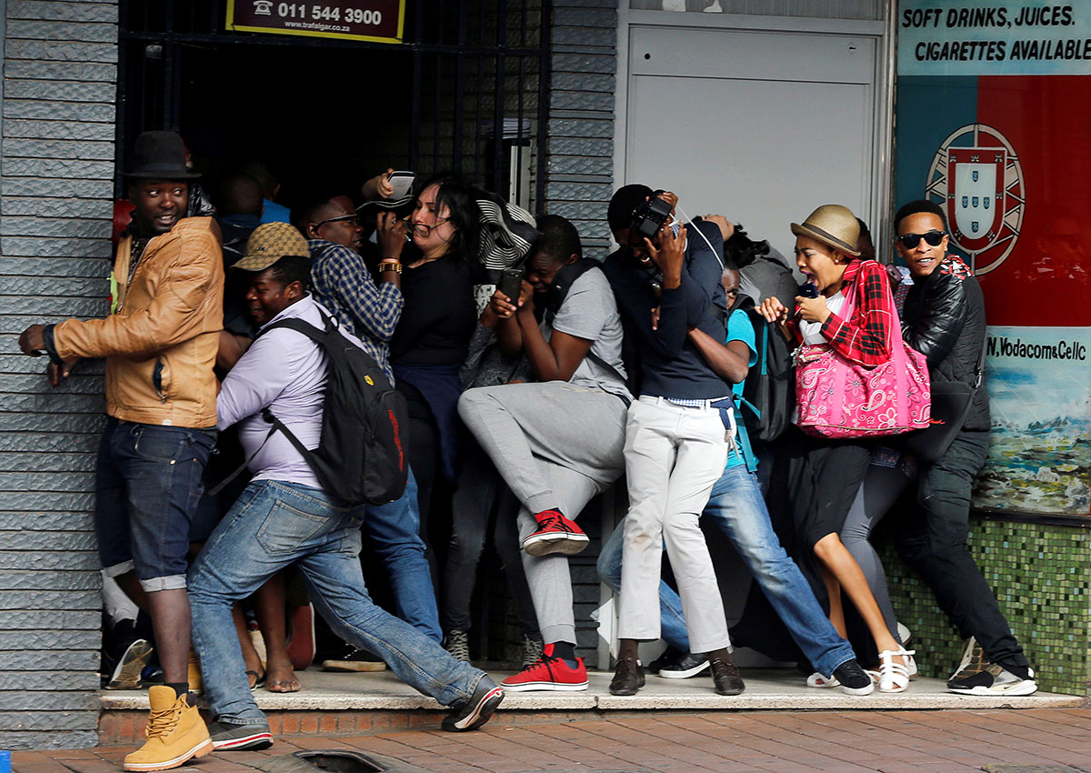 Students Demanding Free Education React As They Are Fired On By Riot Police Officers During A