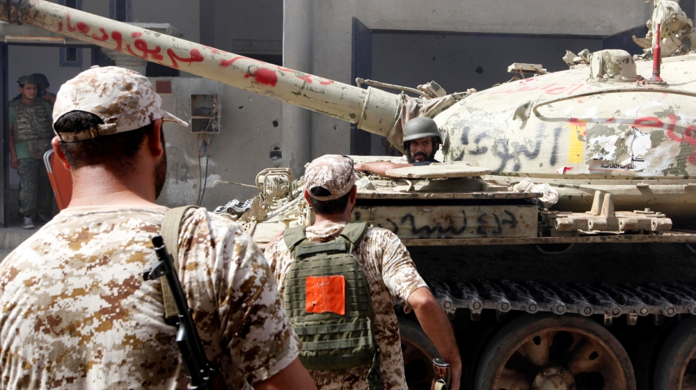 Government troops battling for last stretch of territory in what used to be the group's stronghold in Libya.