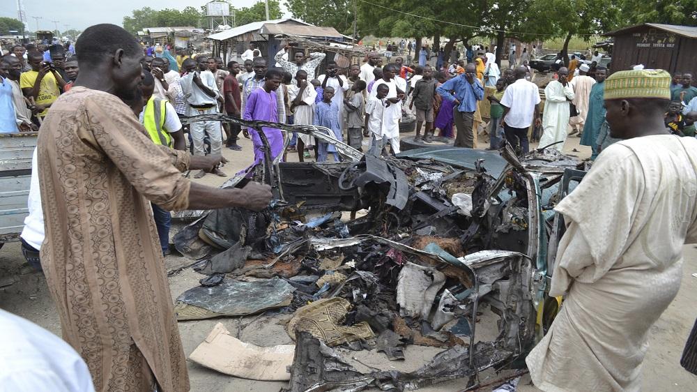 Attacker detonates explosive device in a car in northeastern Maiduguri, leaving at least eight people dead.