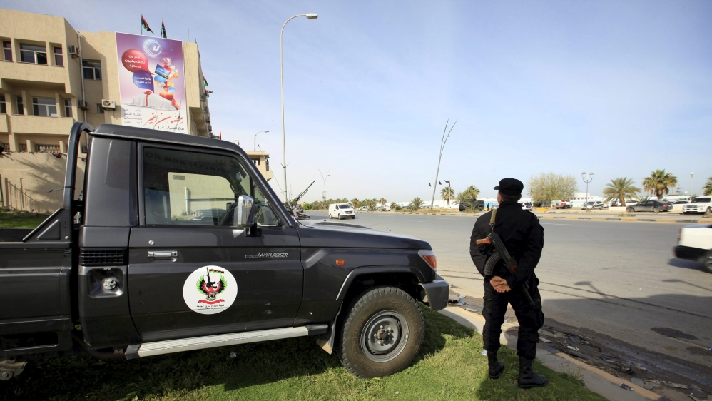 Libya's UN-backed government suffers new setback as rival seizes key offices in Tripoli in a bid to regain power.