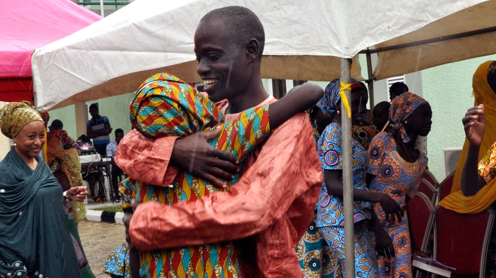 Cries of celebration as released Nigerian girls meet their families after more than two and a half years.