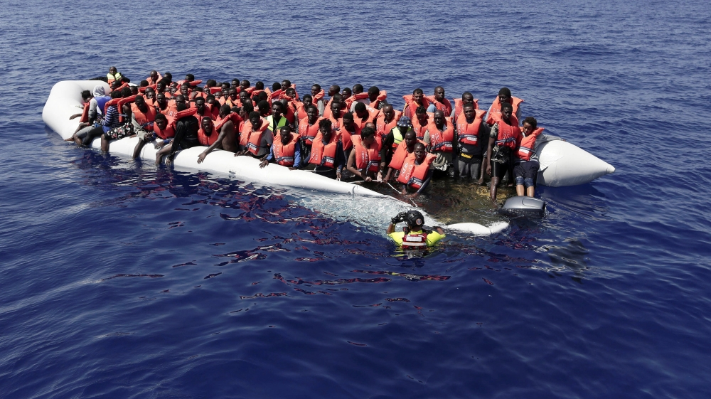Armed men in a speedboat attack overcrowded dinghy, leaving at least 25 people missing off the Libyan coast.