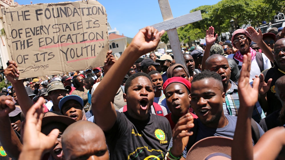 South African police fire stun grenades, water canon and tear gas at student protesters in southern port city.