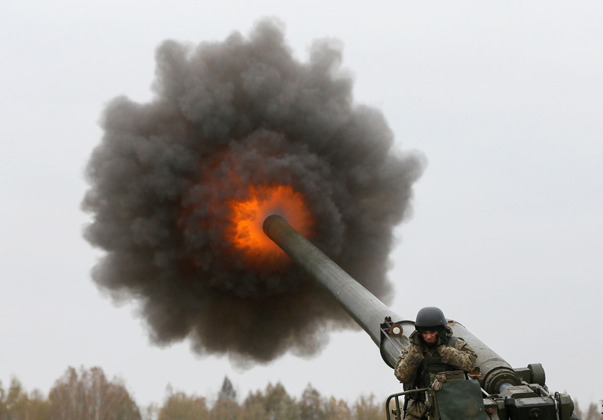 A Ukrainian serviceman fires a 2S7 Pion self-propelled gun during military exercises near the village of Divychky in Ukraine [Valentyn Ogirenko/Reuters]