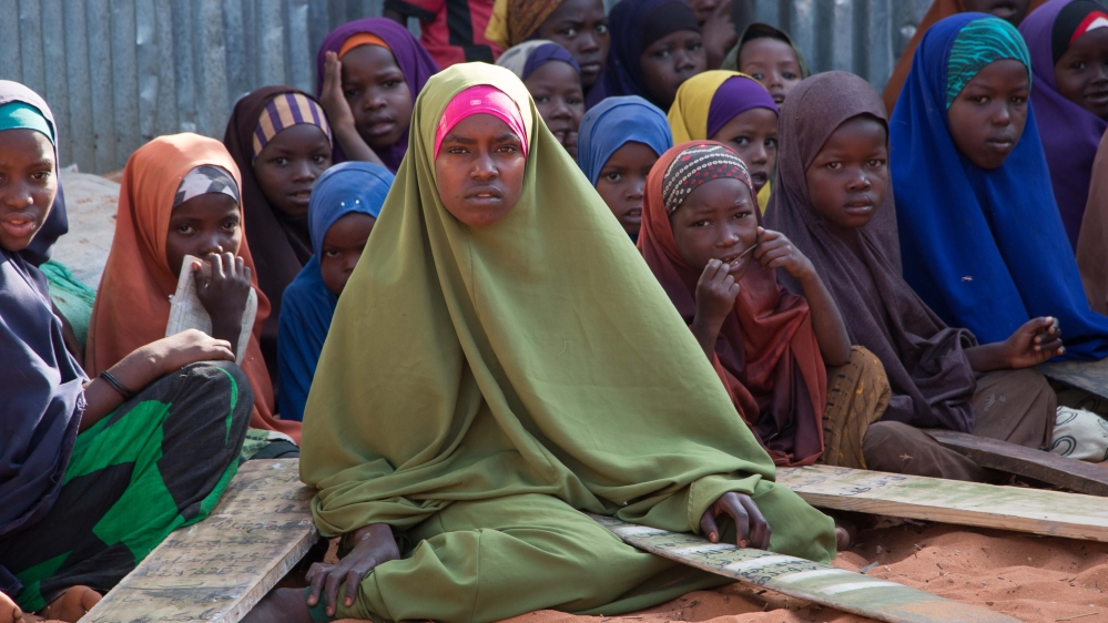 """Somalis are returning to Kismayo in a """"voluntary"""" process to a homeland still stricken by war, drought, and hardship."""