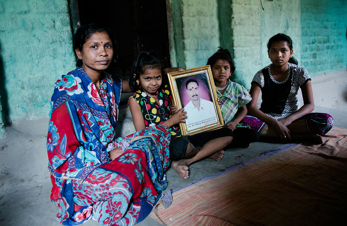 Savita's husband, Jitender, hanged himself from the roof of their home. She is one of the hundreds of widows who is now left to fend for herself. She is now raising her three daughters - Yogini 12, Roshni 10 and Tanu 6 - on her own. She must also repay the debt her husband incurred from private moneylenders and banks. [Deepti Asthana/Al Jazeera]