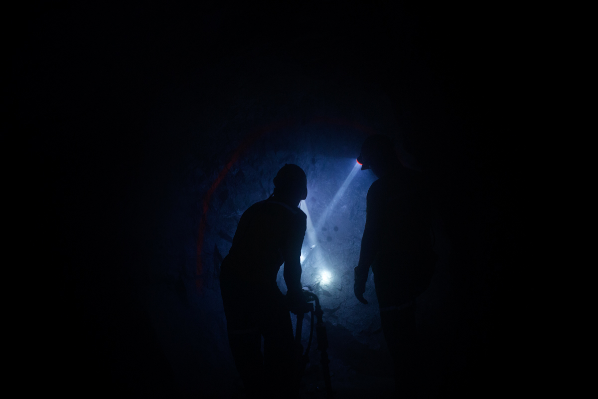 Colombian miners drill a vein of gold inside the Cogote mine. There are more than 700 miners working inside this mine. [Diego Ibarra Sanchez/MeMo/Al Jazeera]