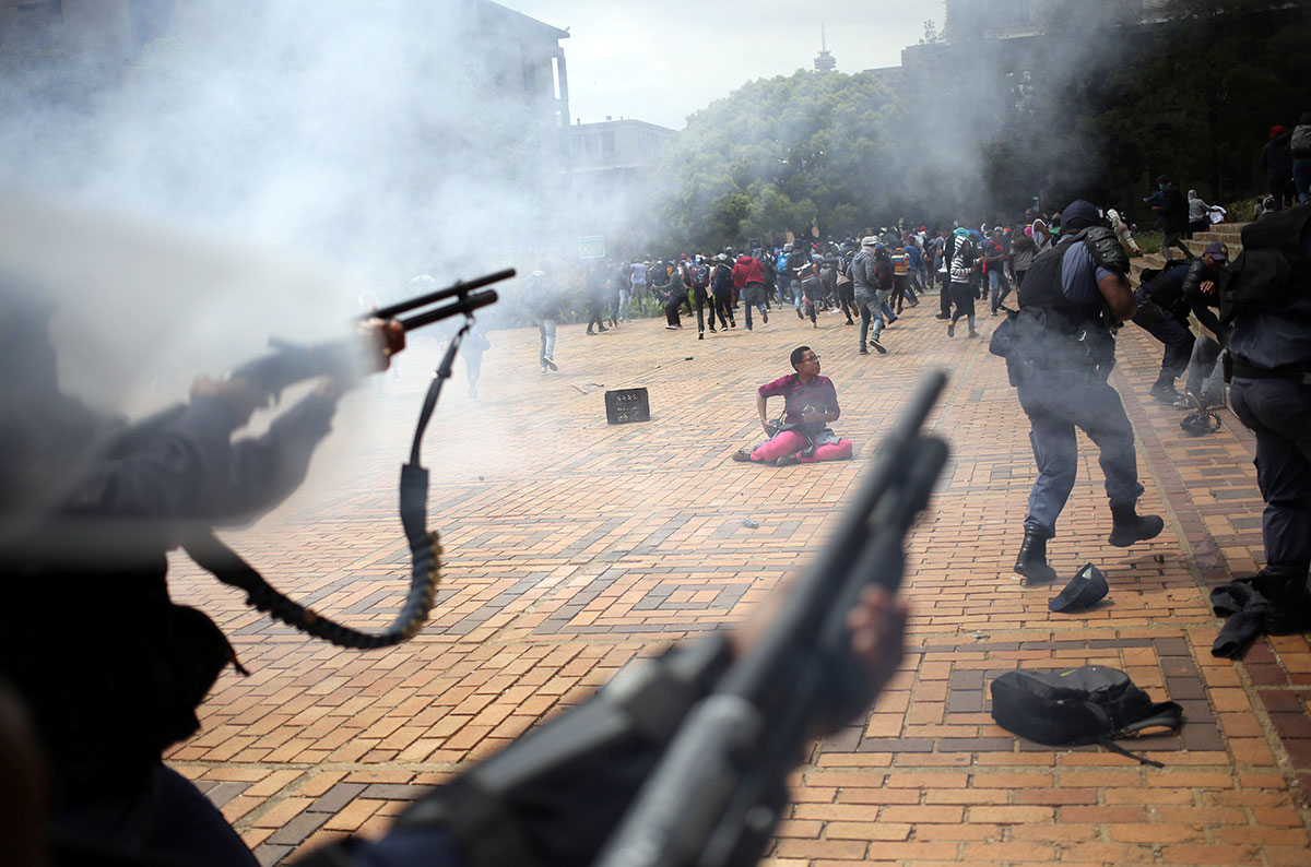 South African students protesting against high tuition fees clash with police at Johannesburg's University of the Witwatersrand. Police fired rubber bullets and set off stun grenades to disperse protesters after the university announced it was re-opening despite demonstrations calling for free education. [Siphiwe Sibeko/Reuters]