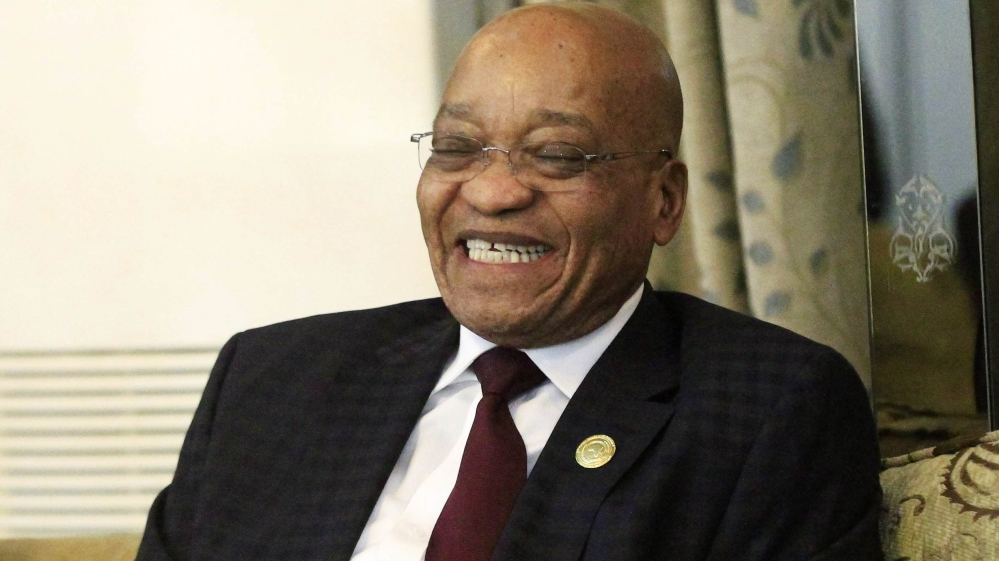 South Africa's ruling ANC votes against motion to remove Zuma as opposition increases calls for him to leave office.