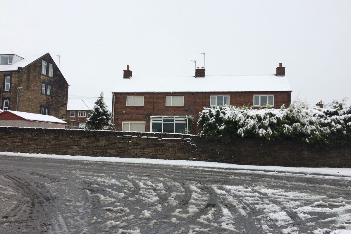 Snow formed down the spine of Northern England, including Huddersfield in West Yorkshire. [Allan Parker]