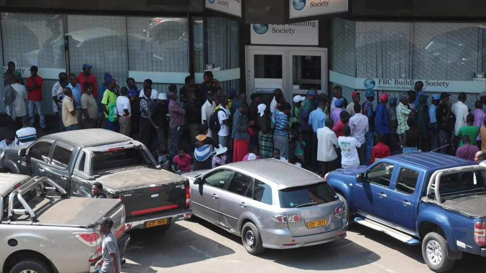 After running out of US dollar reserves, some Zimbabwean banks have limited cash withdrawals to 50 dollars a day.