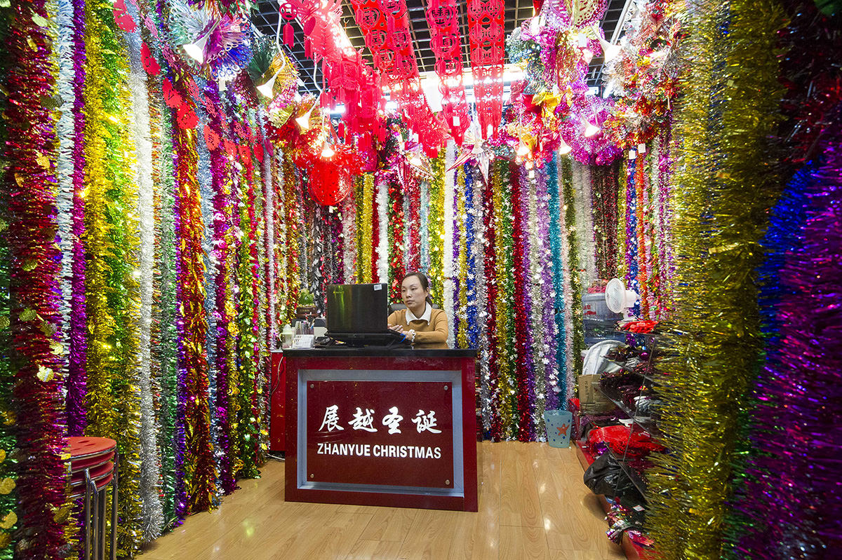 jessica zhang sits in her booth displaying christmas tinsel in the festival arts section of the